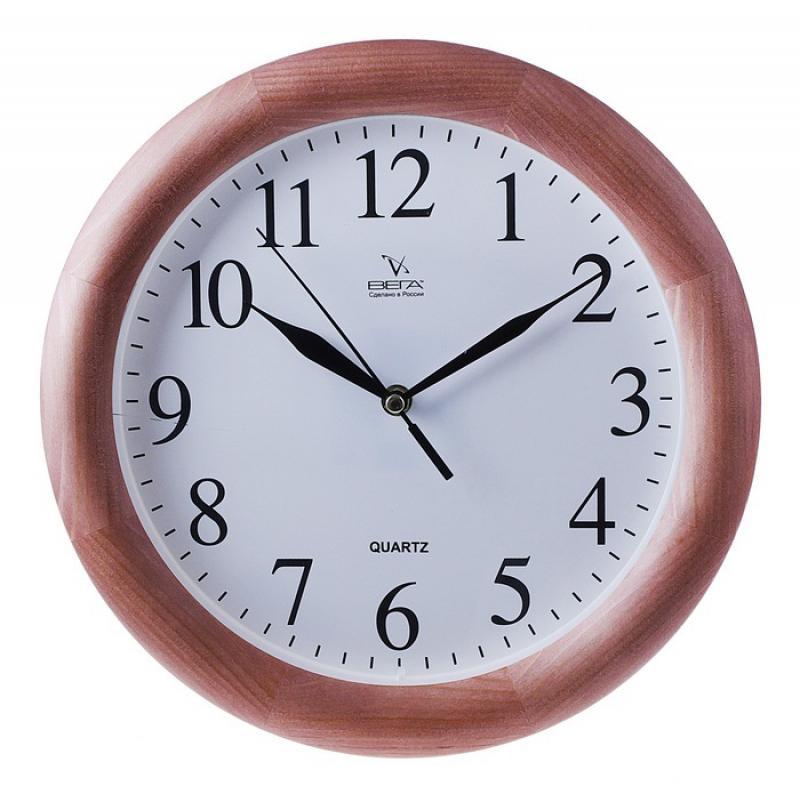 Часы настенные Вега Классика. Д1Д7-754 009303Оригинальные настенные часы круглой формы Вега Классика выполнены из дерева и пластика. Часы имеют три стрелки - часовую, минутную и секундную. Необычное дизайнерское решение и качество исполнения придутся по вкусу каждому. Оформите свой дом таким интерьерным аксессуаром или преподнесите его в качестве презента друзьям, и они оценят ваш оригинальный вкус и неординарность подарка.Часы работают от 1 батарейки типа АА напряжением 1,5 В (в комплект не входит).