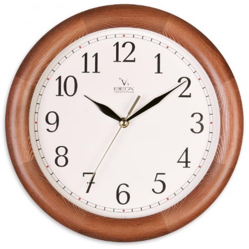 Часы настенные Вега Классика. Д1Д/7-9854 009305Оригинальные настенные часы круглой формы Вега Классика выполнены из дерева и пластика. Часы имеют три стрелки - часовую, минутную и секундную. Необычное дизайнерское решение и качество исполнения придутся по вкусу каждому. Оформите свой дом таким интерьерным аксессуаром или преподнесите его в качестве презента друзьям, и они оценят ваш оригинальный вкус и неординарность подарка.Часы работают от 1 батарейки типа АА напряжением 1,5 В (в комплект не входит).