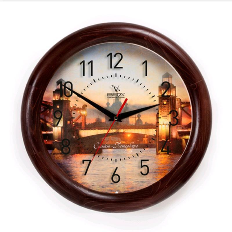 Часы настенные Вега Питер94672Оригинальные настенные часы круглой формы Вега Питер выполнены из дерева и пластика. Часы имеют три стрелки - часовую, минутную и секундную. Необычное дизайнерское решение и качество исполнения придутся по вкусу каждому. Оформите свой дом таким интерьерным аксессуаром или преподнесите его в качестве презента друзьям, и они оценят ваш оригинальный вкус и неординарность подарка.Часы работают от 1 батарейки типа АА напряжением 1,5 В (в комплект не входит).