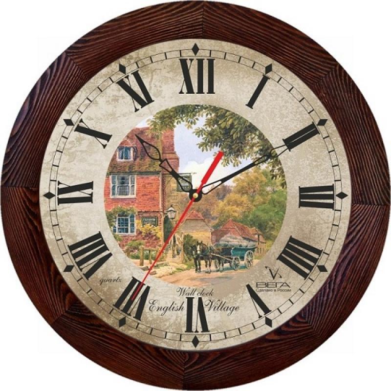 Часы настенные Вега Двор94672Оригинальные настенные часы круглой формы Вега Двор выполнены из дерева и пластика. Часы имеют три стрелки - часовую, минутную и секундную. Необычное дизайнерское решение и качество исполнения придутся по вкусу каждому. Оформите свой дом таким интерьерным аксессуаром или преподнесите его в качестве презента друзьям, и они оценят ваш оригинальный вкус и неординарность подарка.Часы работают от 1 батарейки типа АА напряжением 1,5 В (в комплект не входит).