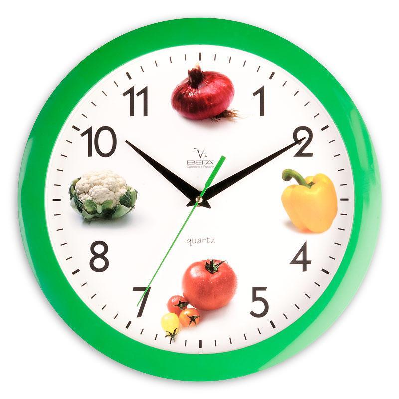 Часы настенные Вега Четыре овоща, диаметр 28,5 смП1-3/7-60Настенные кварцевые часы Вега Четыре овоща, изготовленные из пластика, прекрасно впишутся в интерьер вашего дома. Круглые часы имеют три стрелки: часовую, минутную и секундную, циферблат защищен прозрачным стеклом. Часы работают от 1 батарейки типа АА напряжением 1,5 В (не входит в комплект).