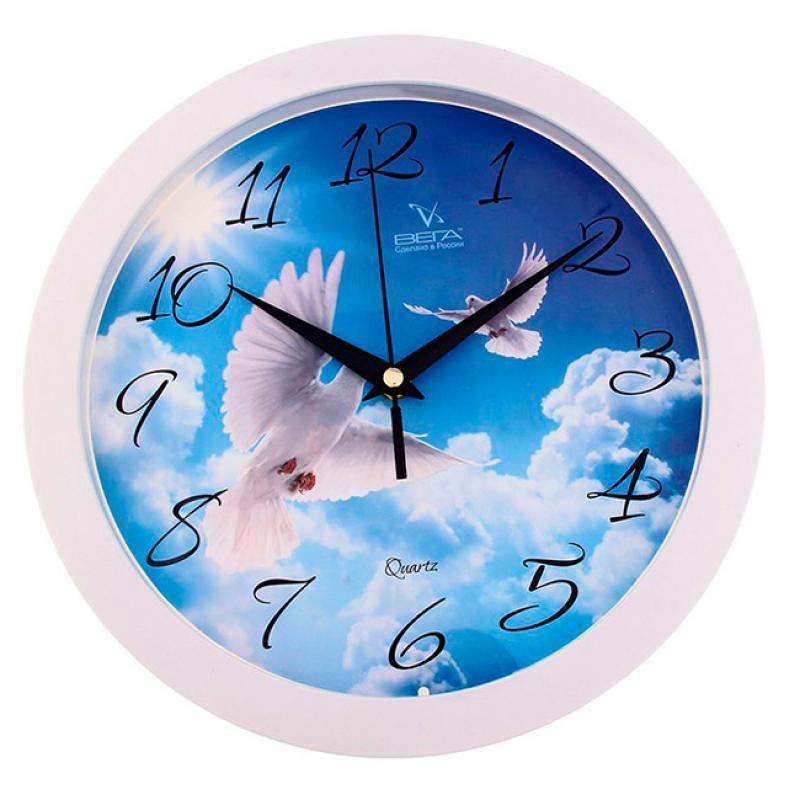 Часы настенные Вега Голубь54 009312Оригинальные настенные часы круглой формы Вега Голубь выполнены из пластика. Часы имеют три стрелки - часовую, минутную и секундную. Необычное дизайнерское решение и качество исполнения придутся по вкусу каждому. Оформите свой дом таким интерьерным аксессуаром или преподнесите его в качестве презента друзьям, и они оценят ваш оригинальный вкус и неординарность подарка.Часы работают от 1 батарейки типа АА напряжением 1,5 В (в комплект не входит).