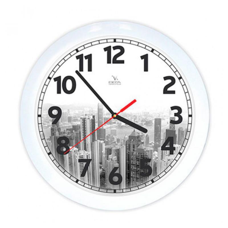 Часы настенные Вега ГородFS-91909Оригинальные настенные часы круглой формы Вега Город выполнены из пластика. Часы имеют три стрелки - часовую, минутную и секундную. Необычное дизайнерское решение и качество исполнения придутся по вкусу каждому. Оформите свой дом таким интерьерным аксессуаром или преподнесите его в качестве презента друзьям, и они оценят ваш оригинальный вкус и неординарность подарка.Часы работают от 1 батарейки типа АА напряжением 1,5 В (в комплект не входит).