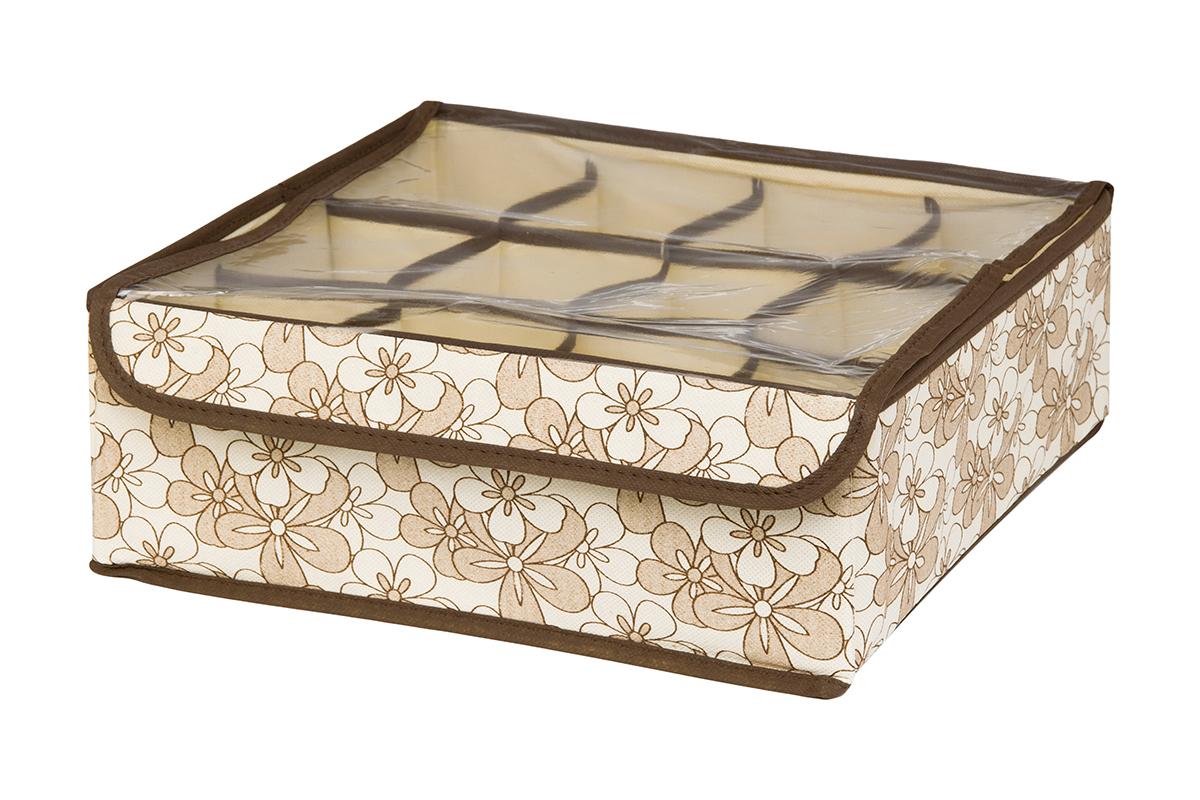 Кофр для хранения EL Casa Цветочное изобилие, 12 секций, 32 х 32 х 12 смБрелок для ключейКофр для хранения EL Casa Европа выполнен из качественного нетканого волокна, которое обеспечивает естественную вентиляцию, отлично пропускает воздух, но не пропускает пыль. Вставки из плотного картона хорошо держат форму. Изделие декорировано красочным рисунком и имеет оригинальный дизайн. Кофр с 12 секциями подходит для хранения нижнего белья, колготок, носков и другой одежды. Прозрачная крышка на липучке, выполненная из ПВХ, позволяет видеть содержимое кофра, не открывая его. Изделие поможет хранить вещи компактно и удобно. Подходит для размещения в шкафу, комоде.