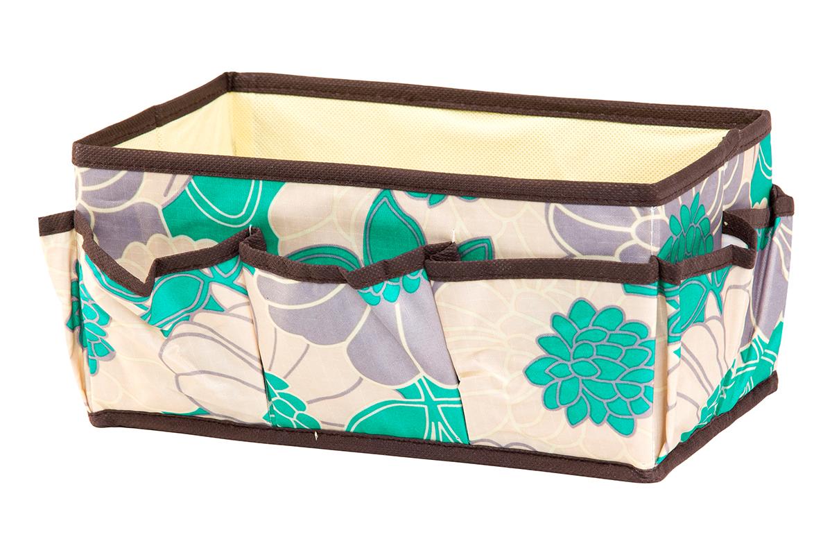 Органайзер для мелочей EL Casa Цветочное поле, 7 карманов, 25 х 15 х 12 см25051 7_желтыйОрганайзер для мелочей EL Casa Цветочное поле выполнен из качественного полиэстера, декорированного красивым цветочным рисунком. Благодаря специальным вставкам из картона изделие прекрасно держит форму. Удобный и компактный органайзер с 7 карманами с легкостью вместит все необходимые баночки и тюбики. Большое основное отделение можно использовать для кремов, парфюмерии и лаков. Наличие различных кармашков делает возможным хранение декоративной косметики и аксессуаров.