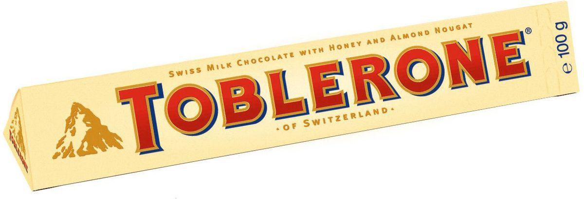 Toblerone шоколад молочный с медово-миндальной нугой, 100 г754260, 4010973Знаменитый швейцарский шоколад Тоблерон треугольной формы. Шоколад Toblerone известен во всем мире благодаря запатентованной треугольной форме, неизменному швейцарскому качеству и характерному сочетанию настоящего молочного швейцарского шоколада, меда и миндальной нуги. Впервые шоколад под торговой маркой Toblerone начал продаваться в Швейцарии в 1908 году и очень скоро стал символом этой удивительной страны.