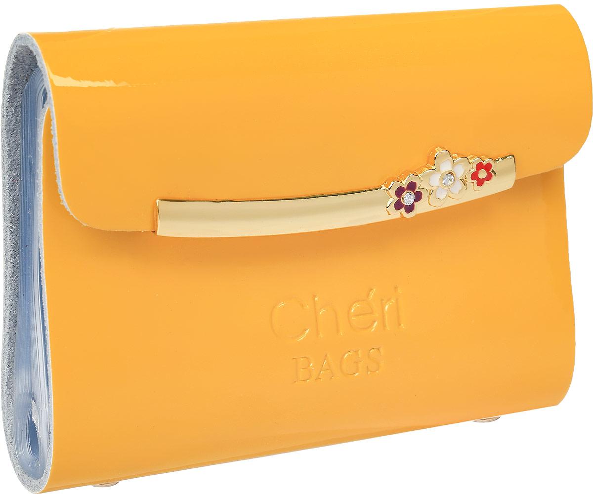 Визитница женская Cheribags, цвет: желтый. V-0494-13EQW-M710DB-1A1Визитница Cheribags выполнена из натуральной лаковой кожи и оформлена тисненой надписью с названием бренда. Внутри расположен блок с 26 файлами для визитных и дисконтных карт. Изделие застегивается клапаном на кнопку.