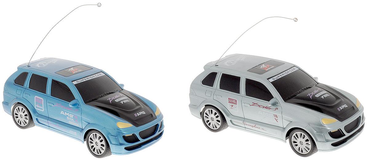 """Набор гоночных машин на радиоуправлении Pilotage """"Top Racer 7"""" с двухканальным управлением 27 и 40MHz - прекрасный подарок для любителей скорости. В данном наборе две гоночных машины в масштабе 1:24 и два пульта управления. Благодаря компактным размерам спортивных автомобилей вы можете устраивать гоночные заезды с друзьями прямо в квартире или в своем офисе! Миниатюрные модели оснащены эффектными кузовами в спортивной раскраске. Они развивают высокую для своего масштаба скорость и выглядят как настоящие гоночные автомобили. Мощный электромотор и отзывчивое управление создают ощущение, что вы управляете настоящим спортивным болидом. Каждая автомодель управляется по двум каналам; движение вперед-стоп-назад, повороты влево-вправо. Пульты управления и машины работают на разной частоте, благодаря чему вы можете запускать обе машины из набора одновременно, не создавая друг другу помех. Этот набор машин доставит вам массу удовольствия. Вы сможете устраивать гонки как..."""