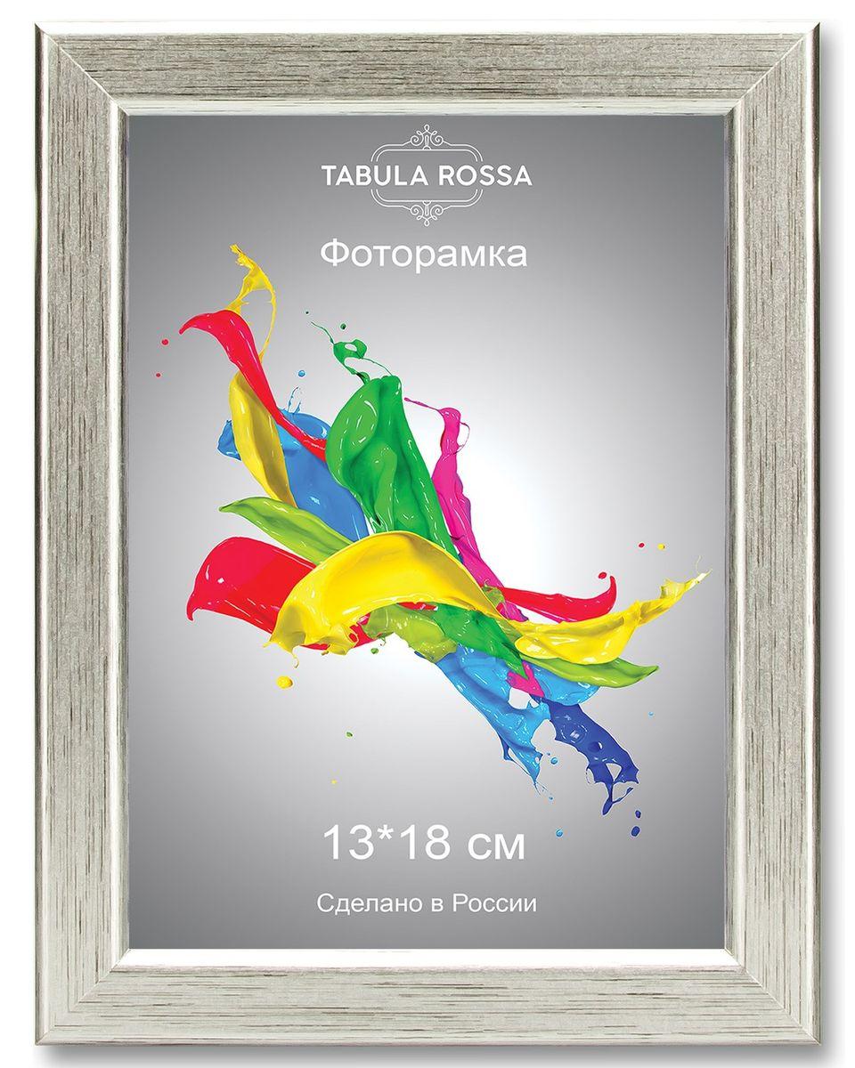 Фоторамка Tabula Rossa, цвет: серебро, 13 х 18 см. ТР 5026CHK-188Фоторамка Tabula Rossa выполнена в классическом стиле из высококачественного МДФ и стекла, защищающего фотографию. Оборотная сторона рамки оснащена специальной ножкой, благодаря которой ее можно поставить на стол или любое другое место в доме или офисе. Также изделие дополнено двумя специальными креплениями для подвешивания на стену.Такая фоторамка не теряет своих свойств со временем, не деформируется и не выцветает. Она поможет вам оригинально и стильно дополнить интерьер помещения, а также позволит сохранить память о дорогих вам людях и интересных событиях вашей жизни.