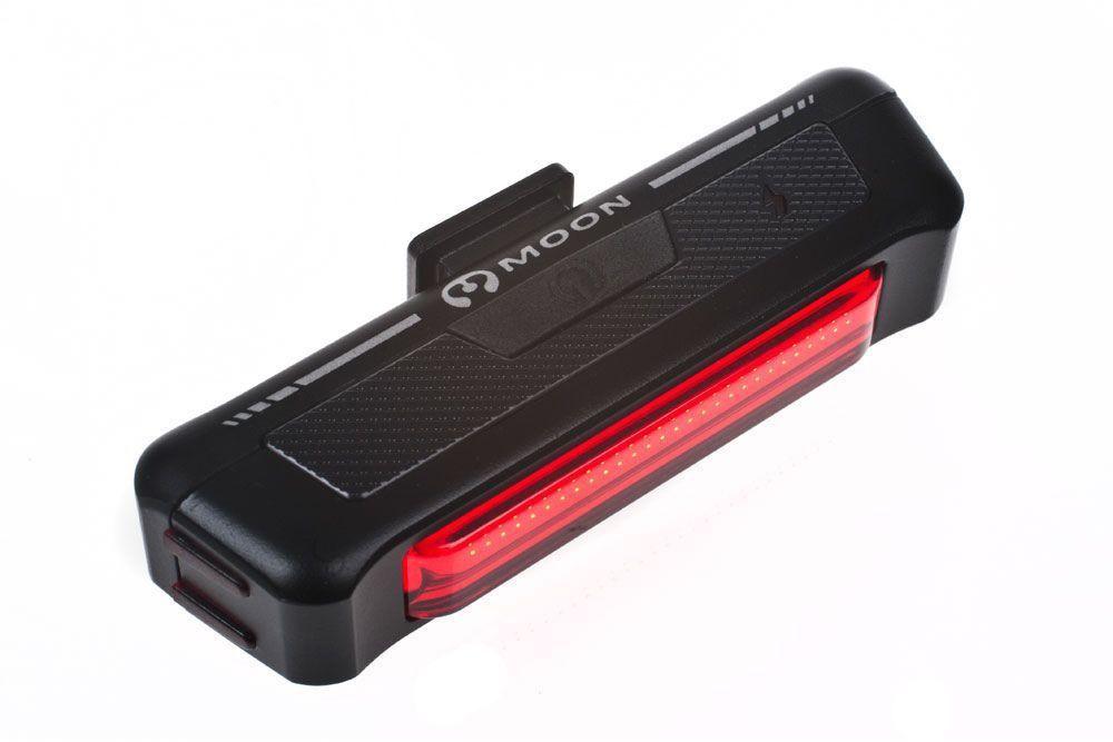 Фонарь задний Moon Comet, 30 диодов, 6 режимов, USBWP_COMET-RТехнические характеристики 30 Led яркая красная лента lithium polymer батарея ( 3.7V 500mAh) 6 вариантов работы : Стандарт /Высоко/Максимум/ 50% мигание /100% мигание /Стробоскоп Быстросьемное крепление Индикатор разряда/заряда батареии Боковая видимость Влагозащищенный USB зарядка Размер:80 x 22 x 17 mm