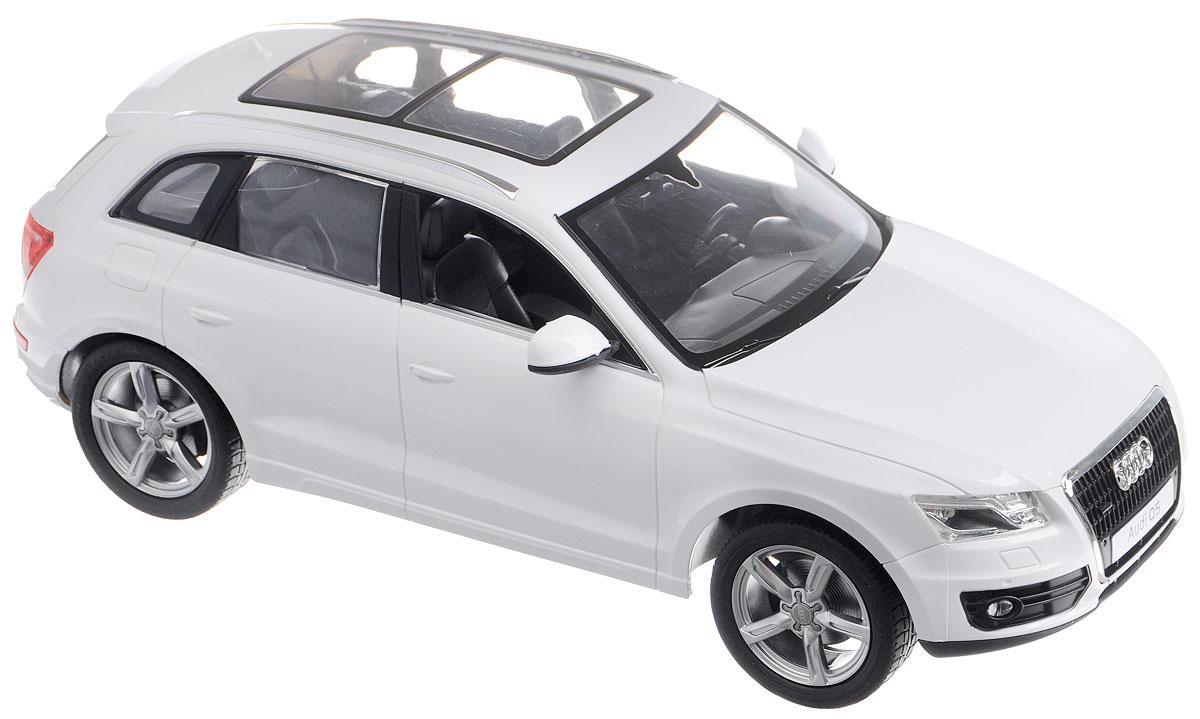"""Радиоуправляемая модель Rastar """"Audi Q5"""" станет отличным подарком любому мальчику! Это точная копия настоящего авто в масштабе 1:14. Авто обладает неповторимым провокационным стилем и спортивным характером. А серьезные габариты придают реалистичность в управлении. Потрясающая маневренность, динамика и покладистость - отличительные качества этой модели. Возможные движения: вперед-назад, вправо-влево. Модель оснащена световыми эффектами (свет передних и задних фар). Подарите вашему ребенку возможность почувствовать себя настоящим водителем. Радиоуправляемые игрушки способствуют развитию координации движений, моторики и ловкости. Машина работает от 5 батареек напряжением 1,5V типа АА (не входят в комплект), пульт управления работает от батарейки 9V типа """"Крона"""" (не входит в комплект)."""