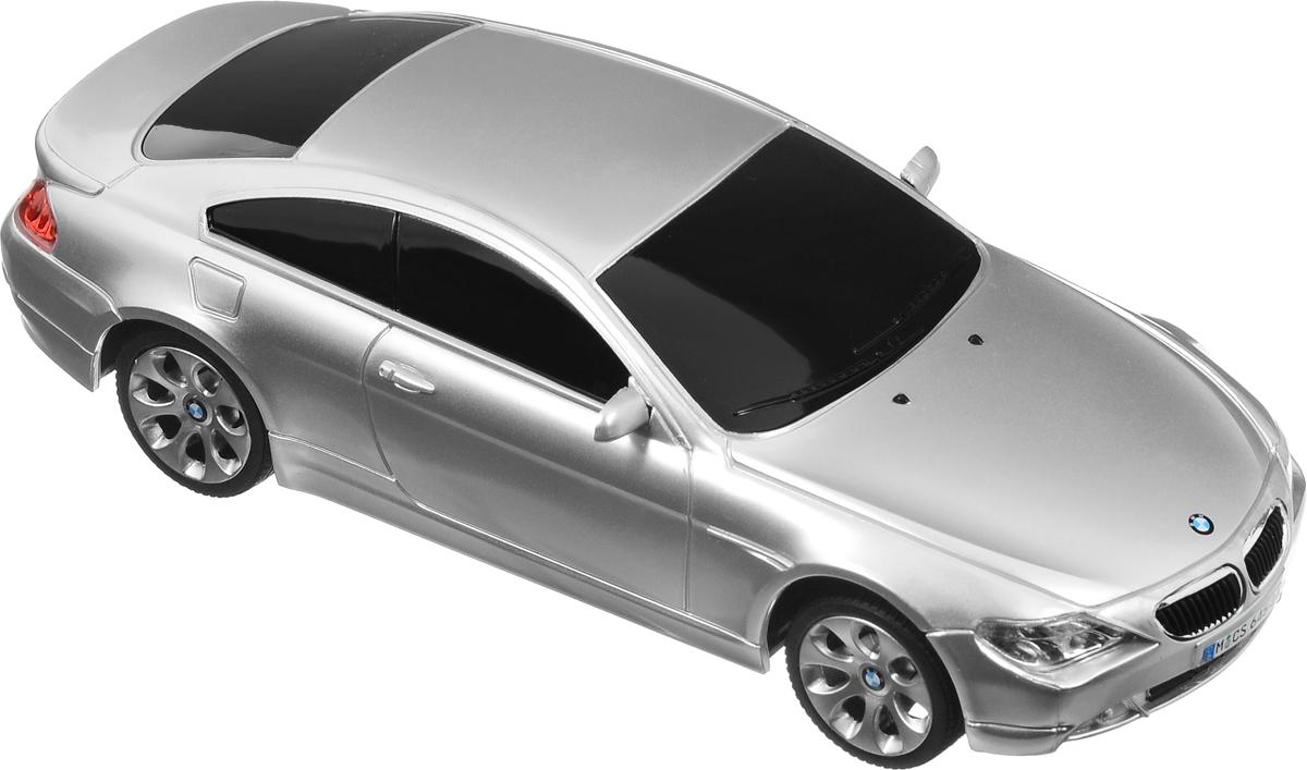 """Радиоуправляемая модель Rastar """"BMW 645Ci"""" предназначена для тех, кто любит роскошь и высокие скорости. Машина представлена в масштабе 1:24 и идеально повторяет форму и дизайн оригинальной модели. Корпус автомобиля выполнен из пластика, колеса прорезинены. Управление машинкой происходит с помощью пульта. Машинка двигается вперед и назад, поворачивает направо и налево. Пульт управления работает на частоте 27 MHz. Авто оснащено световыми эффектами. Радиоуправляемые игрушки способствуют развитию координации движений, моторики и ловкости. Ваш ребенок часами будет играть с моделью, придумывая различные истории и устраивая соревнования. Подарите вашему ребенку возможность почувствовать себя настоящим водителем. Машина работает от 3 батареек напряжением 1,5V типа АА (не входят в комплект). Пульт управления работает от 2 батареек напряжением 1,5V типа АА (не входят в комплект)."""