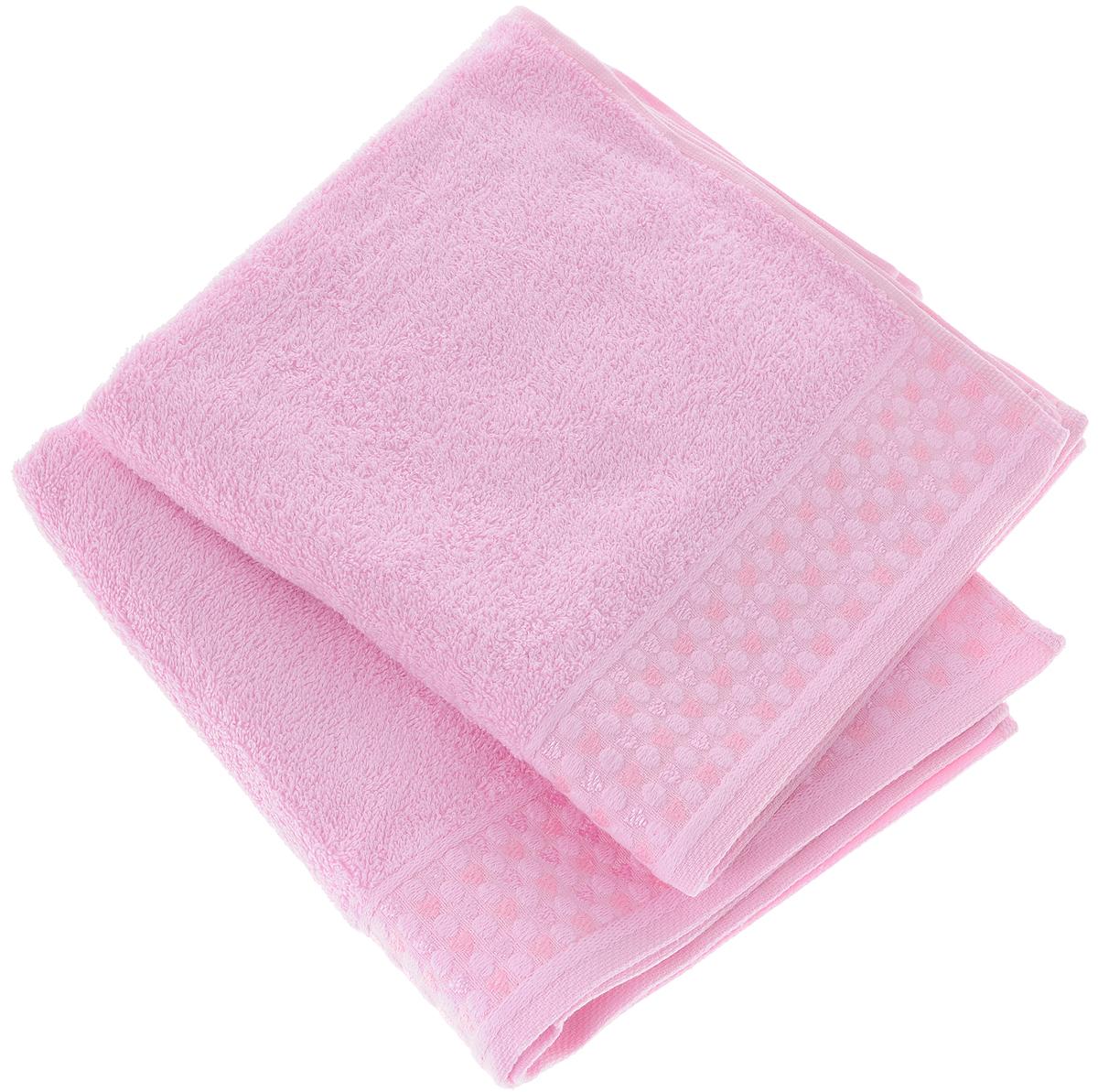 Набор полотенец Tete-a-Tete Сердечки, цвет: розовый, 2 шт. УНП-104-04к68/5/2Набор Tete-a-Tete Сердечки состоит из двух махровых полотенец, выполненных из натурального 100% хлопка. Бордюр полотенец декорирован рисунком сердечек. Изделия мягкие, отлично впитывают влагу, быстро сохнут, сохраняют яркость цвета и не теряют форму даже после многократных стирок. Полотенца Tete-a-Tete Сердечки очень практичны и неприхотливы в уходе. Они легко впишутся в любой интерьер благодаря своей нежной цветовой гамме. Набор упакован в красивую коробку и может послужить отличной идеей подарка.Размеры полотенец: 70 х 140 см, 50 х 90 см.