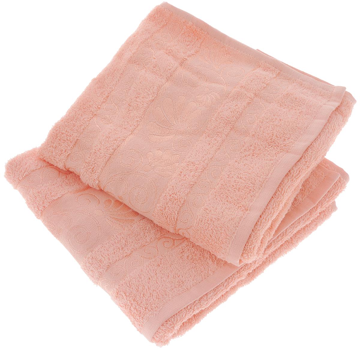 Набор полотенец Tete-a-Tete Цветы, цвет: светло-розовый, 50 х 90 см, 2 штNLED-410-1W-YНабор Tete-a-Tete Цветы состоит из двух махровых полотенец, выполненных из натурального 100% хлопка. Бордюр полотенец декорирован цветочным узором. Изделия мягкие, отлично впитывают влагу, быстро сохнут, сохраняют яркость цвета и не теряют форму даже после многократных стирок. Полотенца Tete-a-Tete Цветы очень практичны и неприхотливы в уходе. Они легко впишутся в любой интерьер благодаря своей нежной цветовой гамме. Набор упакован в красивую коробку и может послужить отличной идеей подарка.Размер полотенец: 50 х 90 см.