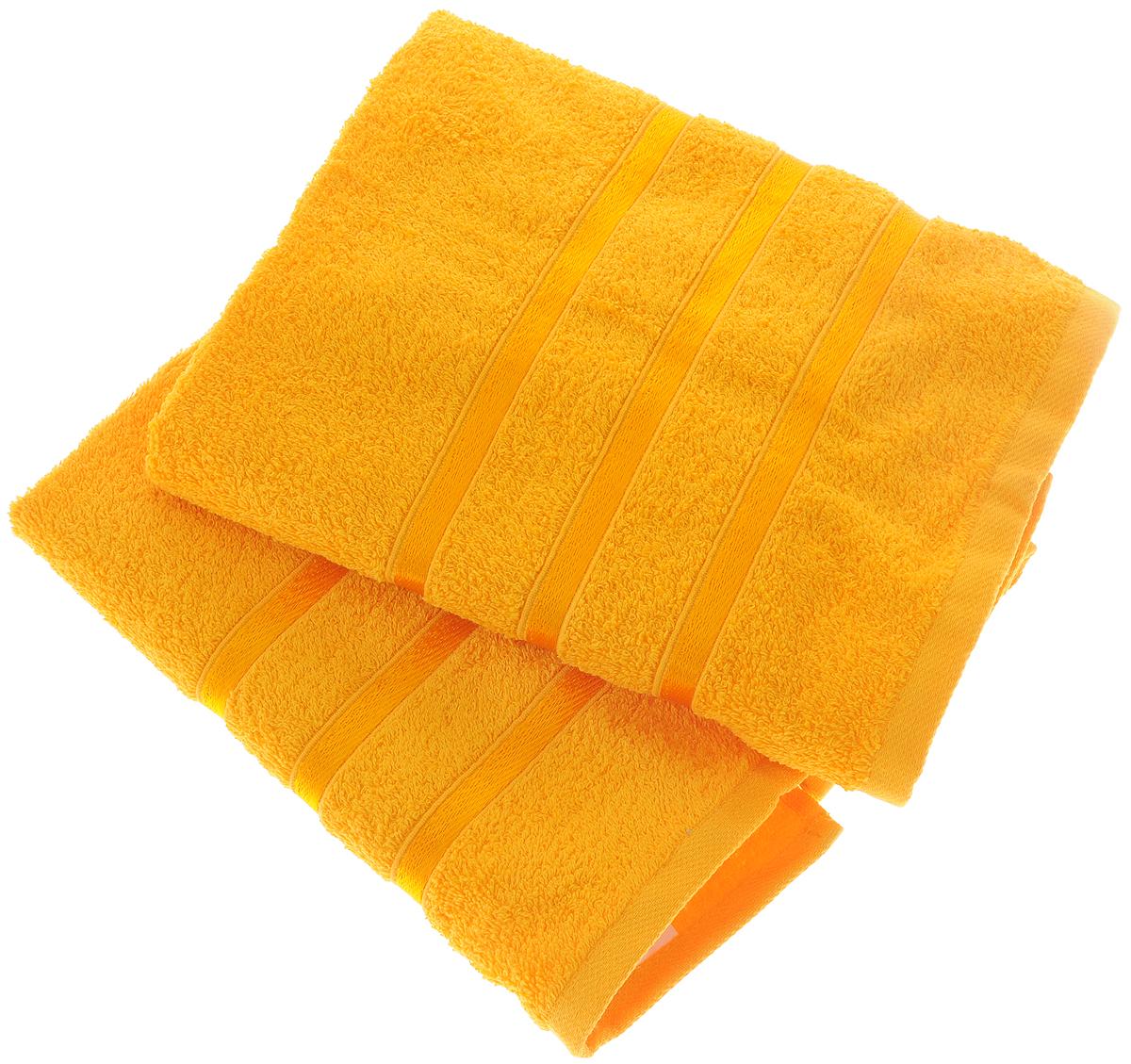 Набор полотенец Tete-a-Tete Ленты, цвет: желтый, 50 х 85 см, 2 шт80663Набор Tete-a-Tete Ленты состоит из двух махровых полотенец, выполненных из натурального 100% хлопка. Бордюр полотенец декорирован лентами. Изделия мягкие, отлично впитывают влагу, быстро сохнут, сохраняют яркость цвета и не теряют форму даже после многократных стирок. Полотенца Tete-a-Tete Ленты очень практичны и неприхотливы в уходе. Они легко впишутся в любой интерьер благодаря своей нежной цветовой гамме. Набор упакован в красивую коробку и может послужить отличной идеей для подарка.Размер полотенец: 50 х 85 см.