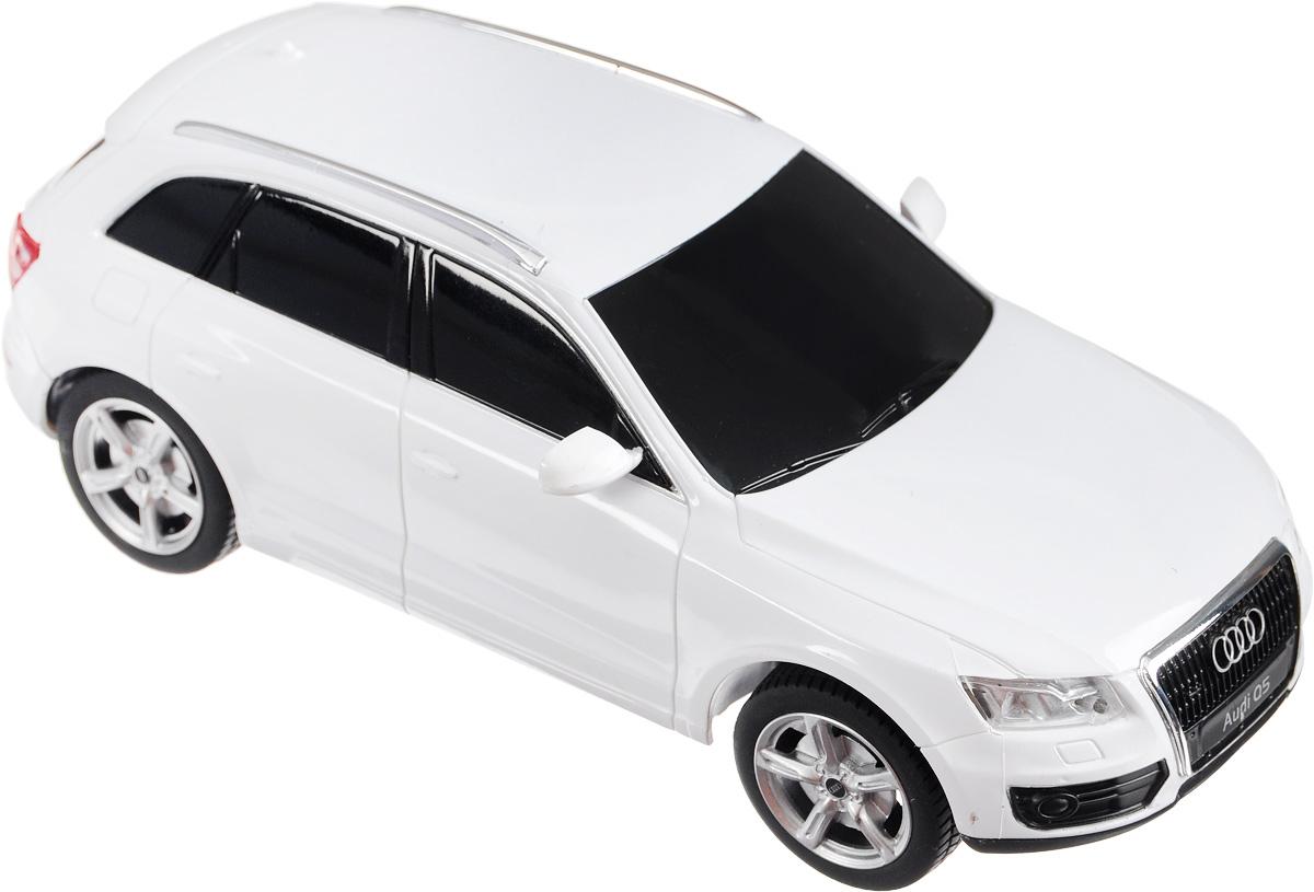 """Радиоуправляемая модель Rastar """"Audi Q5"""" станет отличным подарком любому мальчику! Это точная копия настоящего авто в масштабе 1:24. Авто обладает неповторимым провокационным стилем и спортивным характером. А немалые габариты придают реалистичность в управлении. Потрясающая маневренность, динамика и покладистость - отличительные качества этой модели. Возможные движения: вперед-назад, вправо-влево. Модель оснащена световыми эффектами (свет передних и задних фар). Подарите вашему ребенку возможность почувствовать себя настоящим водителем. Радиоуправляемые игрушки способствуют развитию координации движений, моторики и ловкости. Для работы машинки необходимы 3 батарейки типа АА напряжением 1,5V (не входят в комплект). Для работы пульта управления необходимы 2 батарейки типа АА напряжением 1,5V (не входят в комплект)."""