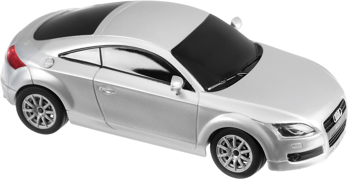 """Радиоуправляемая модель Rastar """"Audi TT"""" обязательно привлечет внимание вашего ребенка! Это прекрасно смоделированная копия реального автомобиля в масштабе 1/24, отличается хорошей детализацией, световыми эффектами и качественным видом. Модель обладает неповторимым провокационным стилем и спортивным характером. Управление машиной происходит при помощи пульта управления. Возможные движения: вперед-назад, вправо-влево. Имеются световые эффекты (свет передних и задних фар). Подарите вашему малышу возможность почувствовать себя настоящим водителем. Для работы машины необходимо купить 3 батарейки типа АА (не входят в комплект). Для работы пульта управления необходимо купить 2 батарейки типа АА (не входят в комплект). Пульт управления работает на частоте 27 MHz."""