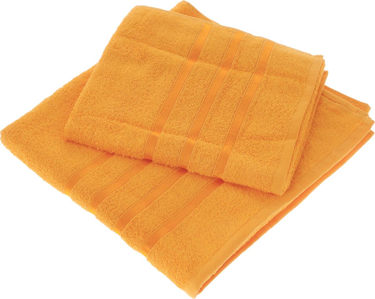 Набор полотенец Tete-a-Tete Ленты, цвет: оранжевый, 2 шт. УНП-10168/5/1Набор Tete-a-Tete Ленты состоит из двух махровых полотенец, выполненных из натурального 100% хлопка. Бордюр полотенец декорирован лентами. Изделия мягкие, отлично впитывают влагу, быстро сохнут, сохраняют яркость цвета и не теряют форму даже после многократных стирок. Полотенца Tete-a-Tete Ленты очень практичны и неприхотливы в уходе. Они легко впишутся в любой интерьер благодаря своей яркой цветовой гамме.