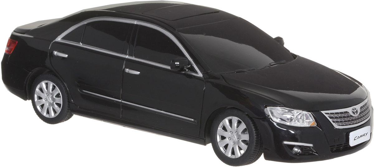 """Радиоуправляемая модель Rastar """"Toyota Camry"""" станет отличным подарком любому мальчику! Это точная копия настоящего авто в масштабе 1:24. Авто обладает неповторимым провокационным стилем и спортивным характером. А серьезные габариты придают реалистичность в управлении. Потрясающая маневренность, динамика и покладистость - отличительные качества этой модели. Возможные движения: вперед-назад, вправо-влево. Модель оснащена световыми эффектами (свет передних и задних фар). Подарите вашему ребенку возможность почувствовать себя настоящим водителем. Радиоуправляемые игрушки способствуют развитию координации движений, моторики и ловкости. Для работы машинки необходимы 3 батарейки типа АА напряжением 1,5V (не входят в комплект). Для работы пульта управления необходимы 2 батарейки типа АА напряжением 1,5V (не входят в комплект)."""