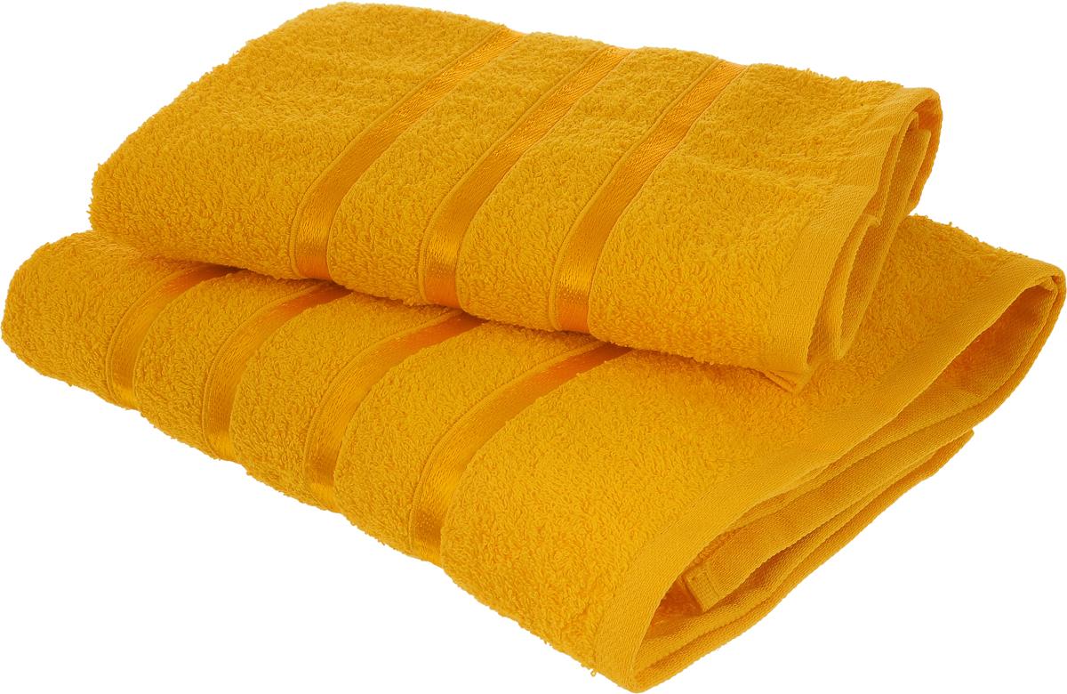 Набор полотенец Tete-a-Tete Ленты, цвет: желтый, 70 х 135 см, 50 х 85 см, 2 шт68/5/1Набор Tete-a-Tete Ленты состоит из двух махровых полотенец, выполненных из натурального 100% хлопка. Бордюр полотенец декорирован вышивкой в виде узких лент. Изделия мягкие, отлично впитывают влагу, быстро сохнут, сохраняют яркость цвета и не теряют форму даже после многократных стирок. Полотенца Tete-a-Tete Ленты очень практичны и неприхотливы в уходе. Они легко впишутся в любой интерьер благодаря своей нежной цветовой гамме. Набор упакован в красивую коробку и может послужить отличной идеей подарка.
