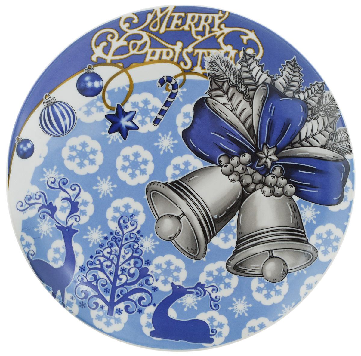 Тарелка Lillo Колокольчики, диаметр 20 смVT-1520(SR)Тарелка Lillo Колокольчики изготовлена из качественной керамики. Изделие декорировано красивым рисунком в виде двух колокольчиков и снежинок. Такая тарелка отлично подойдет в качестве блюда для сервировки закусок и нарезок, ее также можно использовать как обеденную. Тарелка Lillo Колокольчики будет потрясающе смотреться на новогоднем столе. Яркий запоминающийся дизайн и качество исполнения сделают ее отличным новогодним подарком. Не рекомендуется использовать в микроволновой печи и мыть в посудомоечной машине.