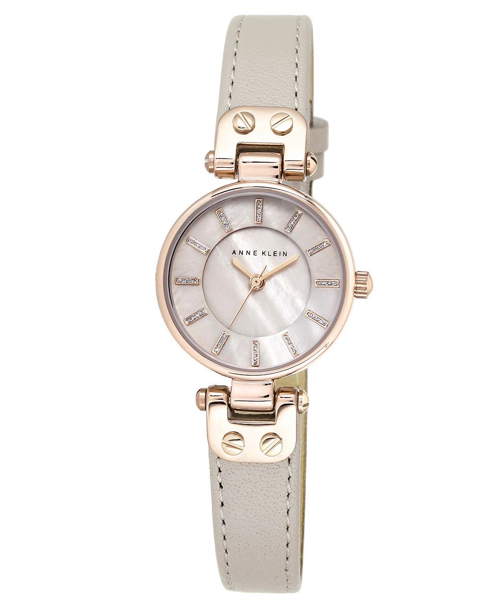 Наручные часы женские Anne Klein, цвет: серый, золотистый. 1950 RGTPBM8434-58AEКорпус: металл, PVD покрытие розового цвета, 26 мм, стекло: минеральное, циферблат перламутровый, браслет: кожаный ремешок серого цвета, механизм: кварцевый, водозащита: 3 АТМ