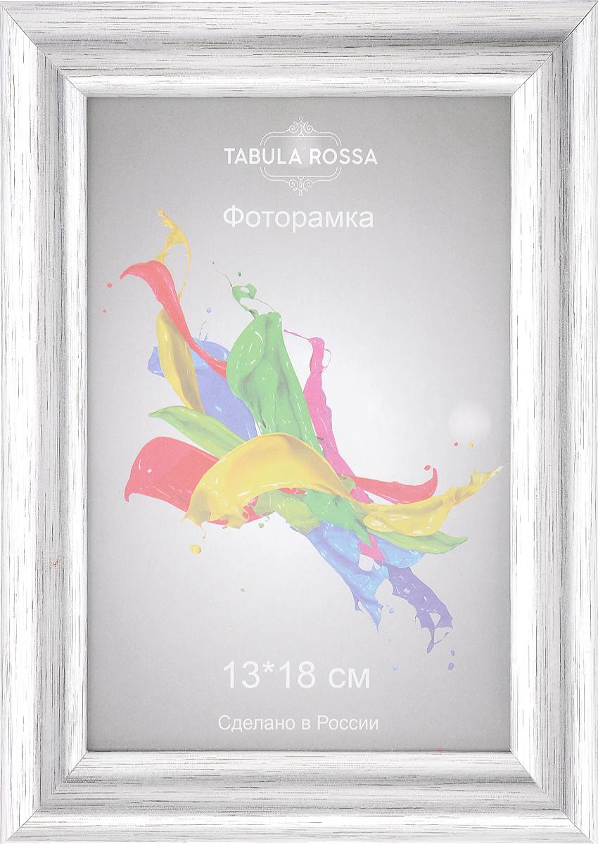 Фоторамка Tabula Rossa Металлик, цвет: серебристый, 13 х 18 см41279Фоторамка Tabula Rossa Металлик выполнена в классическом стиле из пластика, МДФ и стекла, защищающего фотографию. Оборотная сторона рамки оснащена специальной ножкой, благодаря которой ее можно поставить на стол или любое другое место в доме или офисе. Такая фоторамка поможет вам оригинально и стильно дополнить интерьер помещения, а также позволит сохранить память о дорогих вам людях и интересных событиях вашей жизни.Размер фоторамки: 17 х 22,2 см.Подходит для фотографий размером: 13 х 18 см.