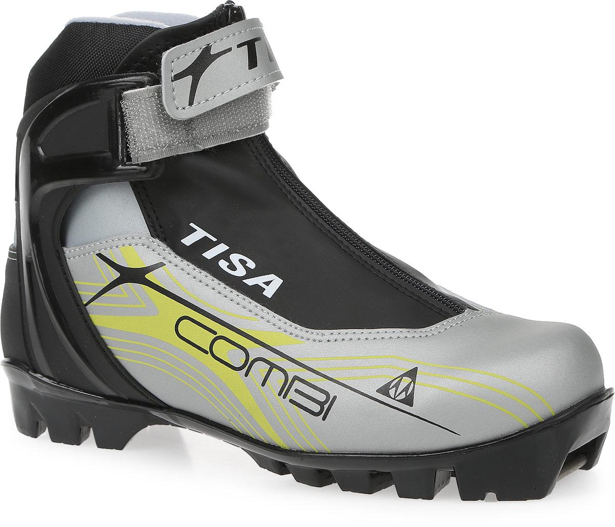 Ботинки лыжные беговые Tisa Combi NNN, цвет: черный, серый, салатовый. Размер 41Karjala Comfort NNNЛыжные ботинки Tisa Combi NNN выполнены из искусственных материалов в классическом стиле и предназначены для лыжных прогулок и туризма. Язык защищен текстильной вставкой на застежке-молнии. Подкладка, исполненная из мягкого флиса и искусственного меха, защитит ноги от холода и обеспечит уют. Верх изделия оформлен удобной шнуровкой с петлями из текстиля. Вставки в мысовой и пяточной частях предназначены для дополнительной жесткости. Манжета Control Cuff поддерживает голеностоп. Подошва системы NNN выполнена из полимерного термопластичного материала. С одной из боковых сторон лыжные ботинки дополнены принтом в виде логотипа бренда.
