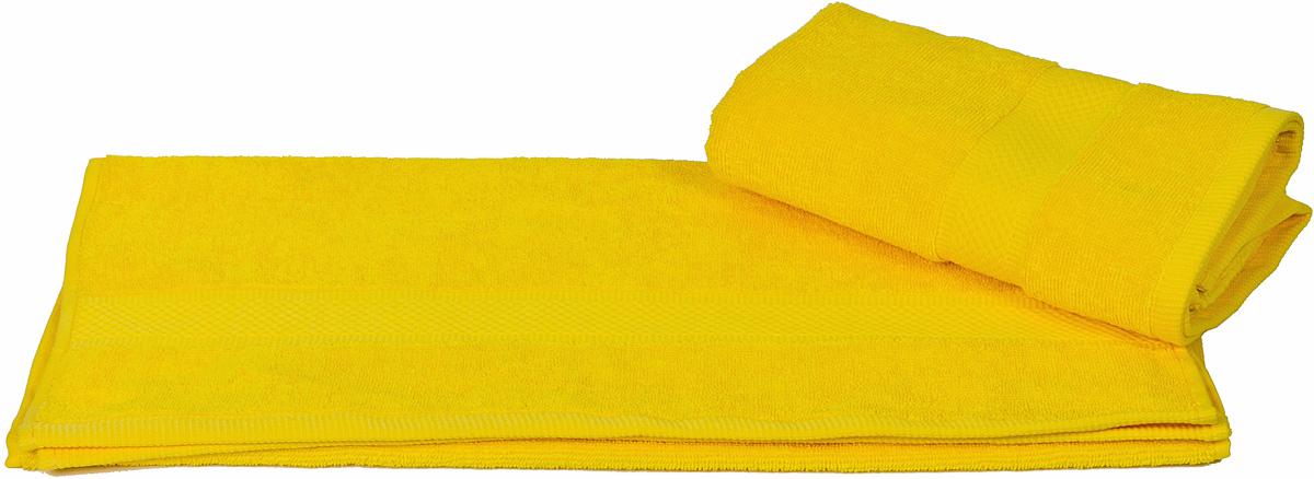 Полотенце Hobby Home Collection Beril, цвет: желтый, 100 х 150 см531-105Полотенце Hobby Home Collection Beril выполнено из 100% хлопка. Изделие отлично впитывает влагу, быстро сохнет, сохраняет яркость цвета и не теряет форму даже после многократных стирок. Такое полотенце очень практично и неприхотливо в уходе. А простой, но стильный дизайн полотенца позволит ему вписаться даже в классический интерьер ванной комнаты.