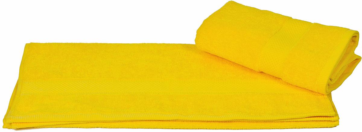 Полотенце Hobby Home Collection Beril, цвет: желтый, 50 х 90 смES-412Полотенце Hobby Home Collection Beril выполнено из 100% хлопка. Изделие отлично впитывает влагу, быстро сохнет, сохраняет яркость цвета и не теряет форму даже после многократных стирок. Такое полотенце очень практично и неприхотливо в уходе. А простой, но стильный дизайн полотенца позволит ему вписаться даже в классический интерьер ванной комнаты.