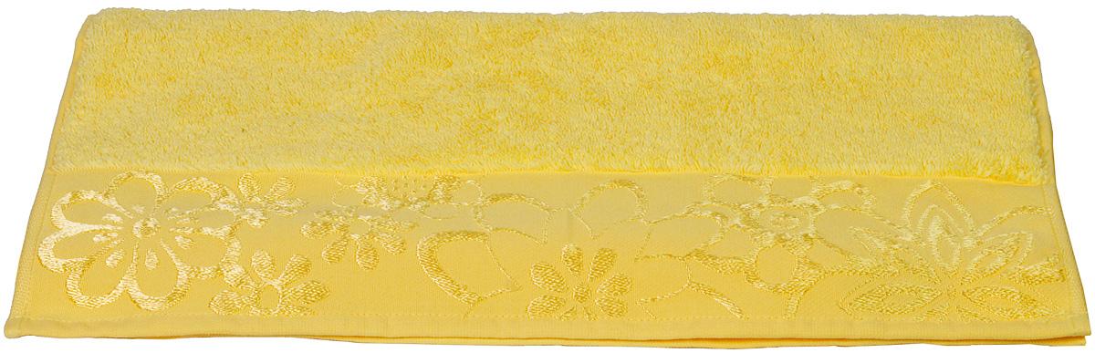 Полотенце Hobby Home Collection Dora, цвет: желтый, 30 х 50 см12723Полотенце Hobby Home Collection Dora выполнено из 100% хлопка. Изделие отлично впитывает влагу, быстро сохнет, сохраняет яркость цвета и не теряет форму даже после многократных стирок. Такое полотенце очень практично и неприхотливо в уходе. А простой, но стильный дизайн полотенца позволит ему вписаться даже в классический интерьер ванной комнаты.