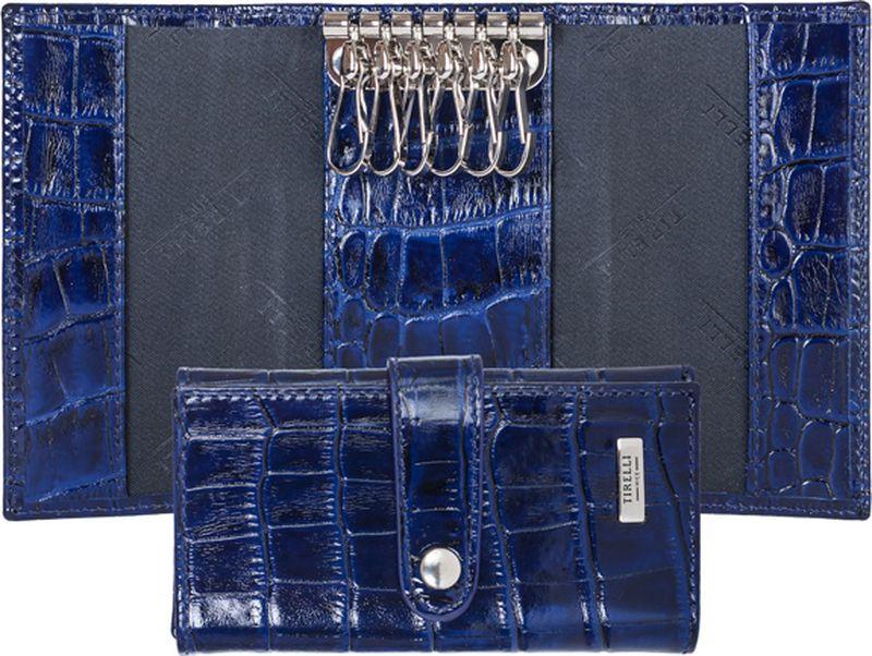 Ключница женская Tirelli, цвет: темно-синий. 15-334-15Ажурная брошьКлючница Tirelli изготовлена из натуральной кожи. Ключница закрывается при помощи хлястика на кнопку. Внутри расположено шесть металлических карабинов для ключейЭтот аксессуар станет замечательным подарком человеку, ценящему качественные и практичные вещи.