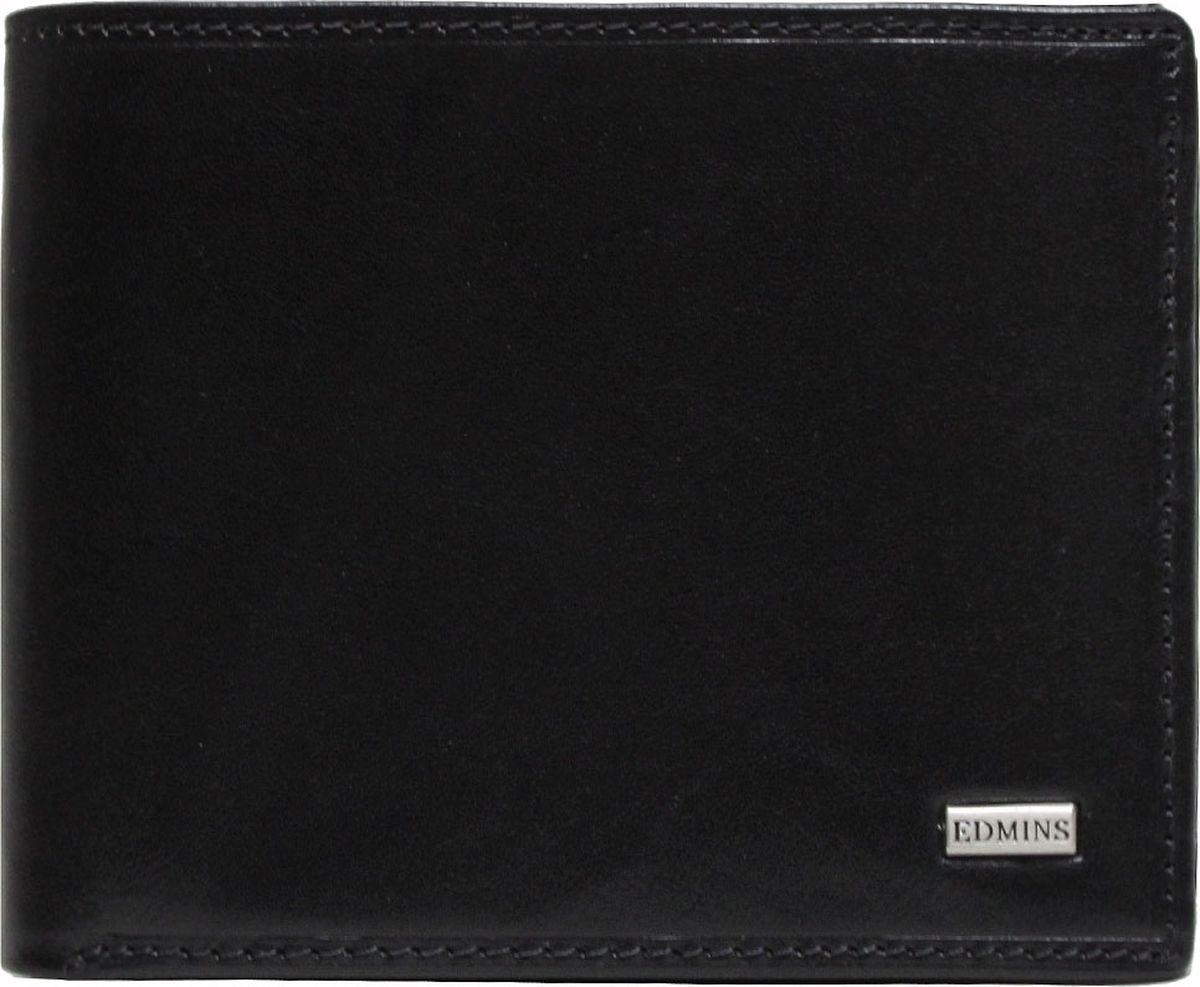 Портмоне мужское Edmins, цвет: черный. 2667 ML EDBM8434-58AEКомпактное портмоне Edmins выполнено из натуральной кожи с гладкой фактурой и оформлено металлическим элементом с символикой бренда. Модель раскладывается пополам и закрывается хлястиком на кнопку. Внутренний функционал: одно отделение для купюр, восемь накладных кармашков для визиток и пластиковых карт, отделение для чеков и мелких бумаг на молнии, карман со вставкой из прозрачного ПВХ. Отделение для мелочи закрывается на кнопку. В коллекциях кожгалантереи Edmins удачно сочетаются итальянская классика и шведский прагматизм, новаторство молодых дизайнеров и работы именитых мастеров, строгая цветовая гамма и смелые эксперименты с цветом. Изделия Edmins, разработанные в Италии, отличает высокое качество кожи, прекрасная износостойкость и актуальность коллекций.Изделие упаковано в фирменную коробку.