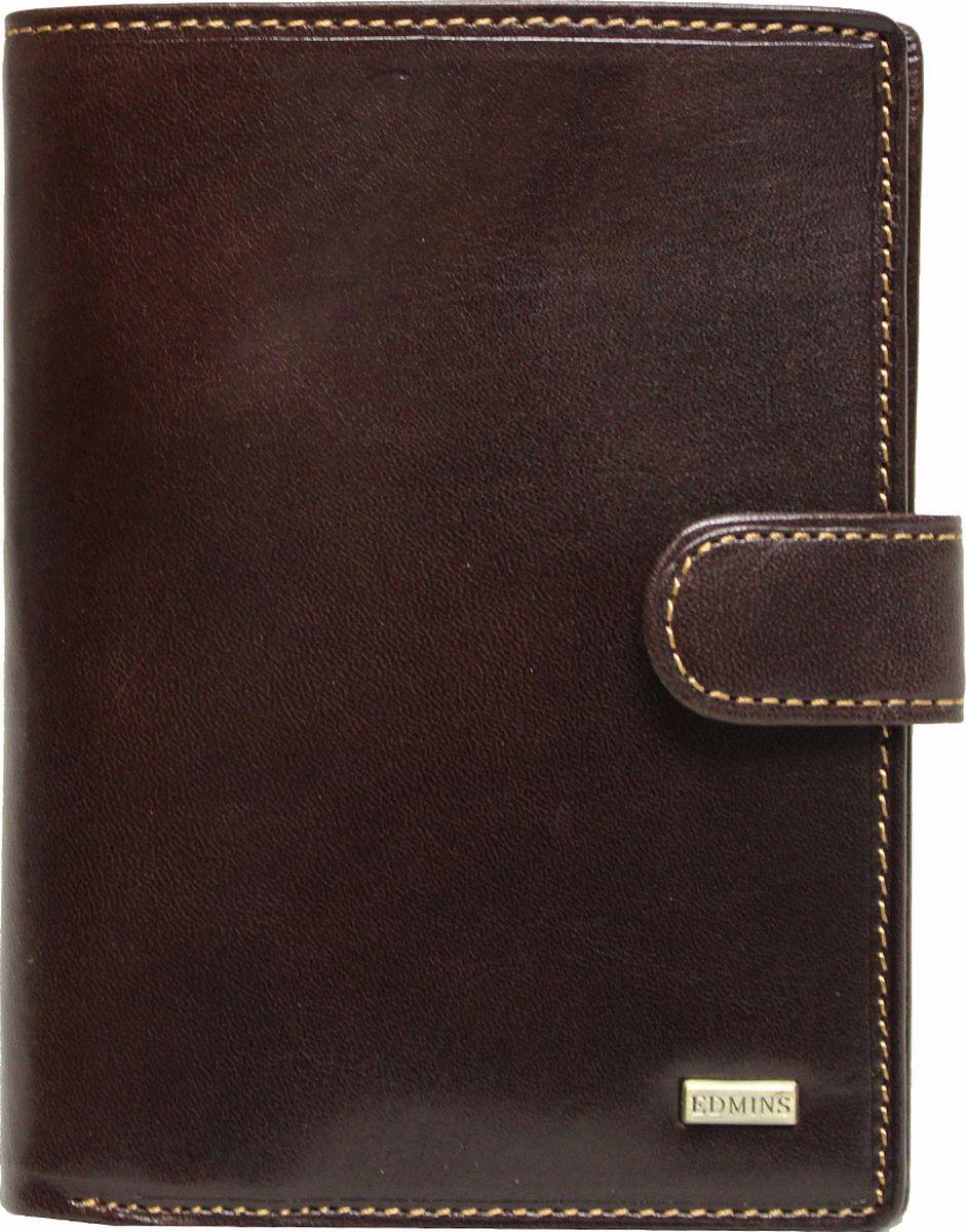 Обложка для документов Edmins, цвет: коричневый. 2242 ML EDW16-11135_914Обложка для документов Edmins выполнена из натуральной кожи с естественной фактурой и оформлена металлическим элементом с символикой бренда и контрастной отстрочкой. Подкладка изготовлена из полиэстера.Изделие раскладывается пополам и закрывается хлястиком на кнопку. Внутри размещены несколько накладных кармашков из прозрачного ПВХ, накладные карманыдля карточек и визиток, а также горизонтальное отделение для купюр или бумаг. В коллекциях кожгалантереи Edmins удачно сочетаются итальянская классика и шведский прагматизм, новаторство молодых дизайнеров и работы именитых мастеров, строгая цветовая гамма и смелые эксперименты с цветом. Изделия Edmins, разработанные в Италии, отличает высокое качество кожи, прекрасная износостойкость и актуальность коллекций.Изделие упаковано в фирменную коробку.