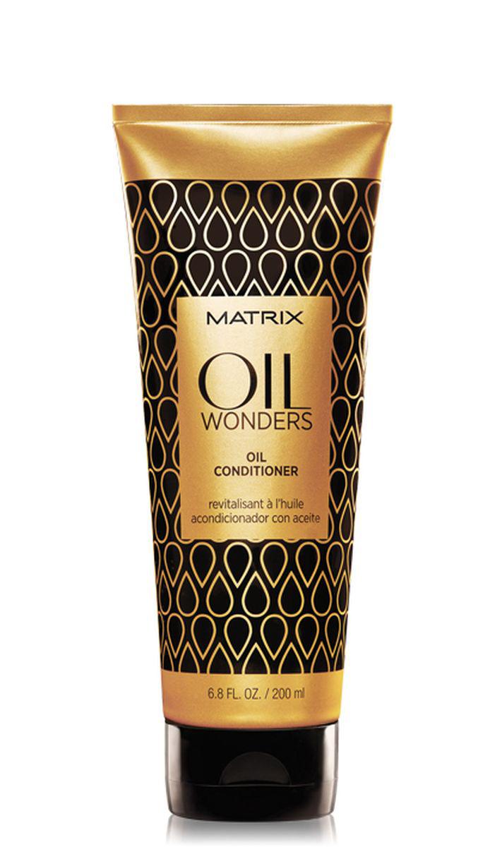 Matrix Oil Wonders Кондиционер с маслом, 200 млFS-36054Невесомый кондиционер Oil Wonders (Ойл Вандерс), обогащенный Марокканским аргановым маслом, возвращает волосам дисциплину, делает их мягкими на ощупь. Придает дополнительное сияние, разглаживая кутикулу волоса, тем самым упрощая процесс укладки.- Невесомое кондиционирование и питание волоса- Подходит для всех типов волос.