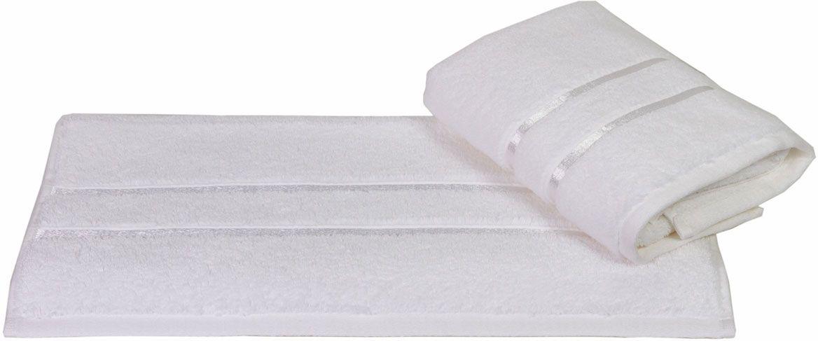 Полотенце Hobby Home Collection Dolce, цвет: белый, 70 х 140 см531-105Полотенце Hobby Home Collection Dolce выполнено из 100% хлопка. Изделие отлично впитывает влагу, быстро сохнет, сохраняет яркость цвета и не теряет форму даже после многократных стирок. Такое полотенце очень практично и неприхотливо в уходе. А простой, но стильный дизайн полотенца позволит ему вписаться даже в классический интерьер ванной комнаты.