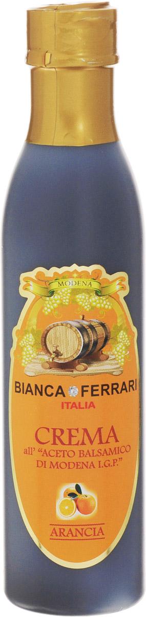 Bianca Ferrari ди Модена Апельсин крем-соус на основе бальзамического уксуса, 250 мл549Крем-соус из бальзамического уксуса - это заправка на базе бальзамического уксуса из Модены. Соус не подвергают тепловой обработке и используют в качестве украшения, приправы или дрессинга к салатам, мясу, рыбе, десертам и другим блюдам. Как и бальзамический уксус, крем богат минералами, антиоксидантами и витаминами группы B.IGP (Indicazione Geografica Protetta) - защищенный указатель географического происхождения.Бальзамический уксус из Модены - это название защищено специальным знаком IGP. Для получения марки IGP нужно, чтобы хотя бы одна из фаз процесса изготовления проходила в рамках конкретной географической зоны.Уважаемые клиенты! Обращаем ваше внимание, что полный перечень состава продукта представлен на дополнительном изображении.
