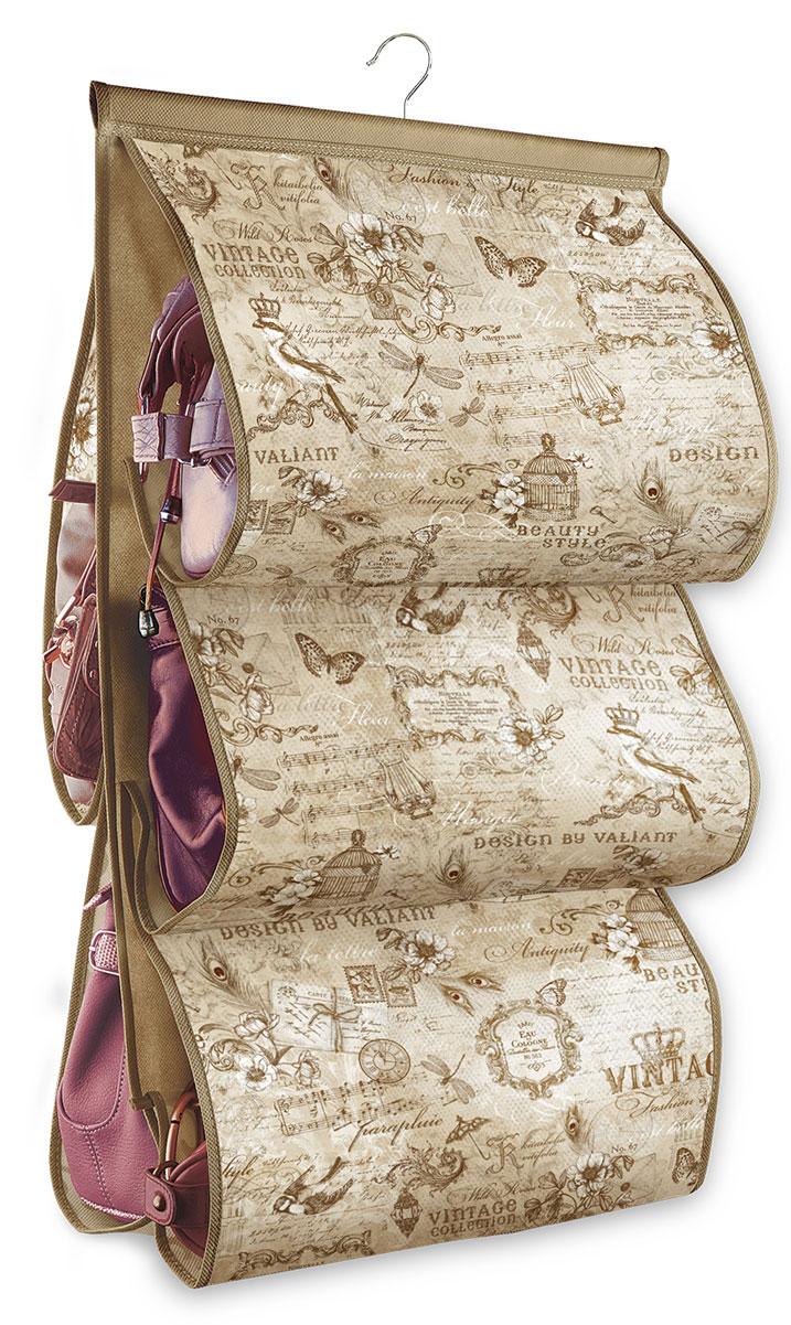 Кофр подвесной для сумок Valiant Vintage, с вешалкой, 5 карманов, 42 x 72 смБрелок для ключейПодвесной кофр Valiant Vintage, изготовленный из высококачественного нетканого материала с оригинальным принтом, предназначен для хранения сумок. Благодаря специальному крючку, кофр можно повесить в шкафу как обычную вешалку, а эстетичный дизайн гармонично смотрится в любом интерьере. Изделие имеет 5 секций. Подвесной кофр Vintage - это новый взгляд на систему хранения - теперь хранить вещи не только удобно, но и красиво.Размер кофра: 42 х 72 см. Количество секций: 5.