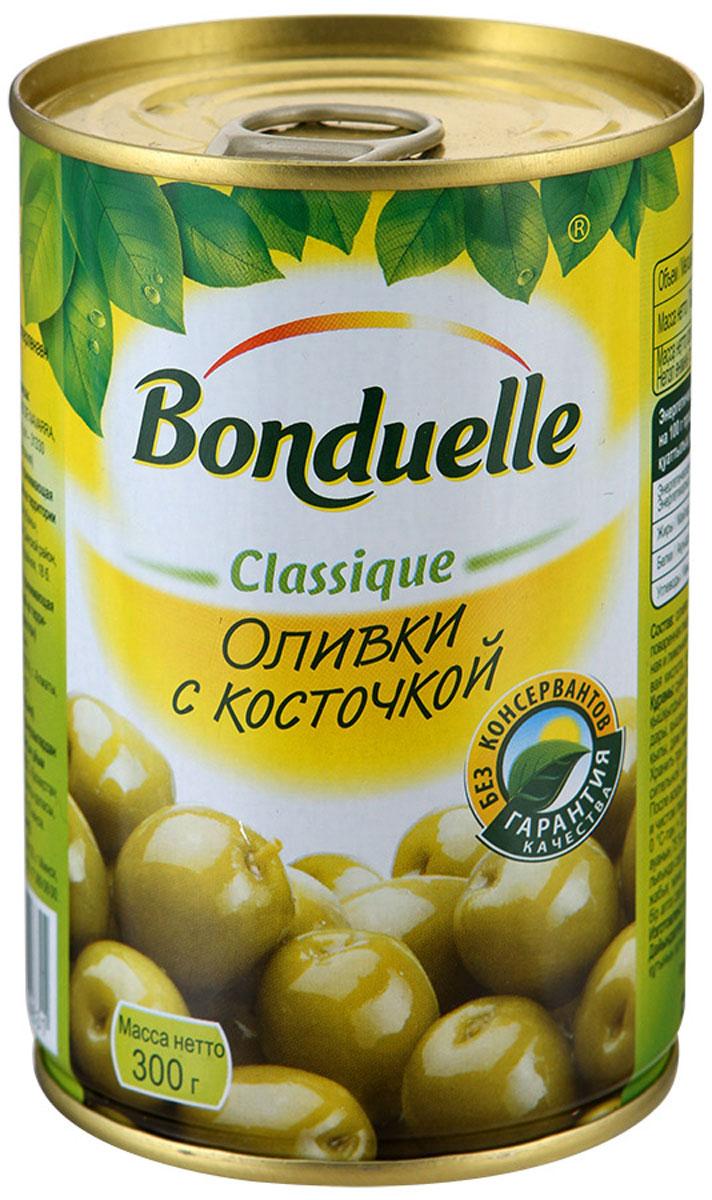 Bonduelle оливки с косточкой, 300 г0710084Оливки с косточкой Bonduelle сочетают в себе изысканный вкус и чрезвычайно полезные свойства.Молодые плоды оливкового дерева, проходя процесс консервации, практически не утрачивают своей ценности. Оливки богаты калием, кальцием и железом, содержат витамины групп B, C, E, полезные органические вещества.Употребление оливок благотворно влияет на различные процессы организма, например, способствует улучшению микрофлоры кишечника, укрепляет стенки сосудов, регулирует процессы свертывания крови. Удивительно вкусные, ароматные оливки идеально сочетаются с вином и сыром, а также прекрасно дополняют различные закуски.Уважаемые клиенты! Обращаем ваше внимание, что полный перечень состава продукта представлен на дополнительном изображении.