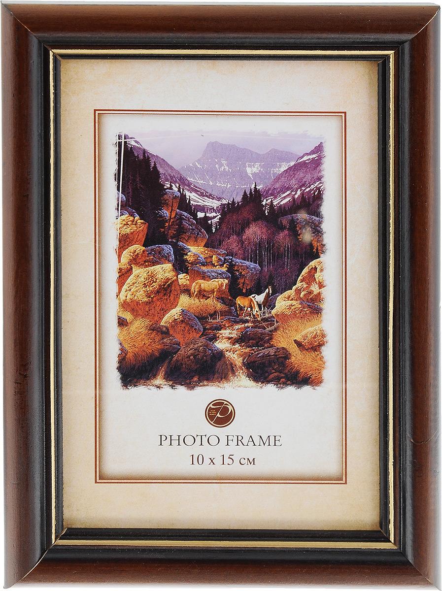 Фоторамка Pioneer Carol, цвет: темно-коричневый, 10 x 15 см12723Фоторамка Pioneer Carol выполнена в классическом стиле из натурального дерева и стекла, защищающего фотографию. Оборотная сторона рамки оснащена специальной ножкой, благодаря которой ее можно поставить на стол или любое другое место в доме или офисе. Такая фоторамка поможет вам оригинально и стильно дополнить интерьер помещения, а также позволит сохранить память о дорогих вам людях и интересных событиях вашей жизни.