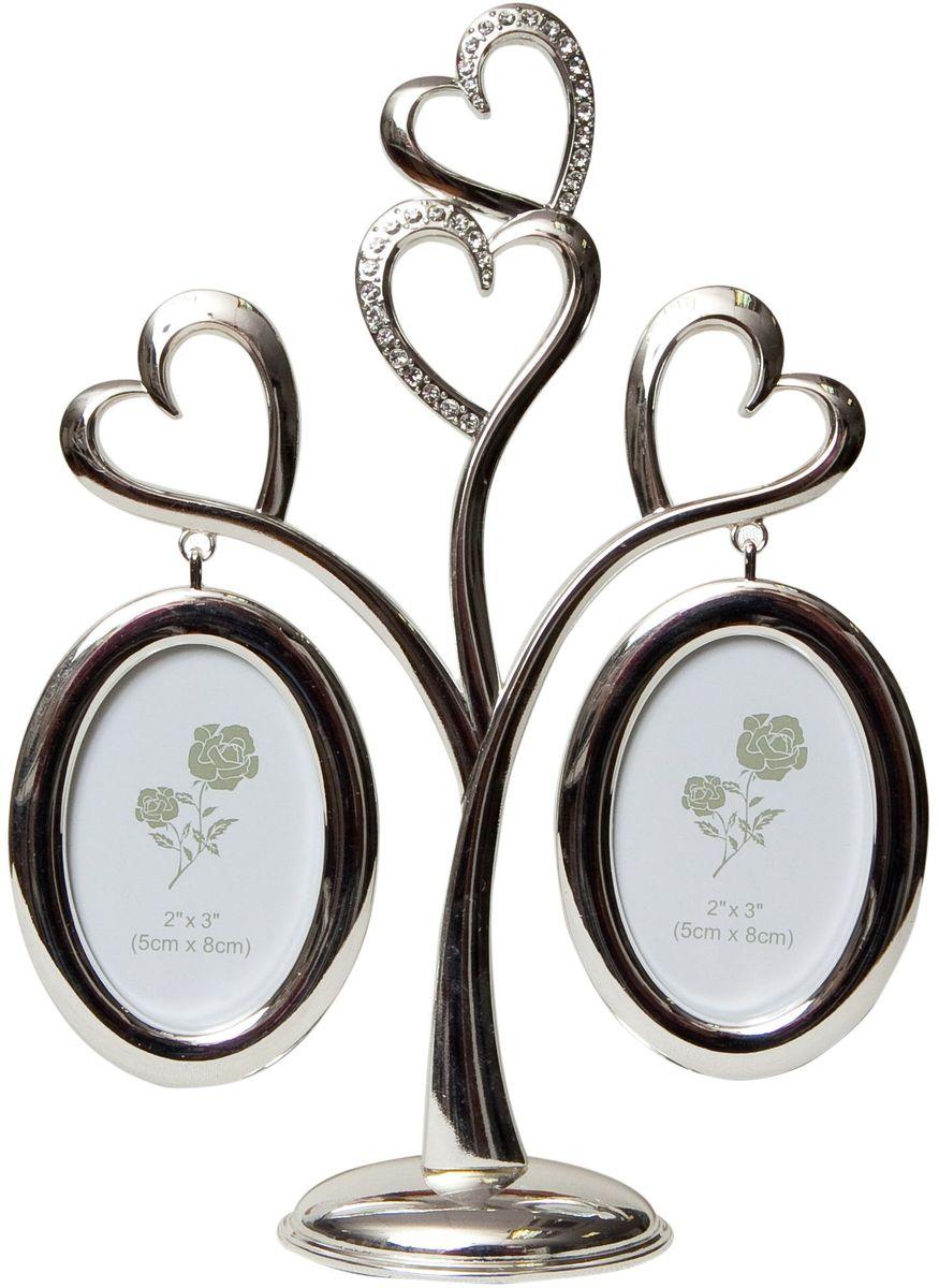 Фоторамка Platinum Дерево. Сердца, цвет: светло-серый, на 2 фото, 8 x 8 см. PF10019A41619Декоративная фоторамкаPlatinum Дерево. Сердца выполнена из металла. На дереве в виде сердец подвешиваются две овальные рамочки. Фоторамка украшена стразами. Изысканная и эффектная, эта потрясающая рамочка покорит своей красотой и изумительным качеством исполнения. Декоративная фоторамкаPlatinum Дерево. Сердца не только украсит интерьер помещения, но и поможет разместить важные для вас фотографии. Высота фоторамки: 22 см. Фоторамка подходит для фотографий 8 x 8 см.Общий размер фоторамки: 17 х 4 х 22 см.