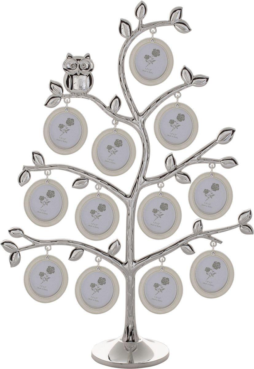 Фоторамка Platinum Дерево, цвет: светло-серый, на 12 фото, 4 x 5 см. PF10726U210DFДекоративная фоторамка Platinum Дерево выполнена из металла и декорирована стразами. На подставку в виде деревца подвешиваются двенадцать овальных рамочек. Изысканная и эффектная, эта потрясающая рамочка покорит своей красотой и изумительным качеством исполнения. Декоративная фоторамкаPlatinum Дерево не только украсит интерьер помещения, но и поможет разместить фото всей вашей семьи. Высота фоторамки: 36 см. Фоторамка подходит для фотографий 4 x 5 см.Общий размер фоторамки: 30,5 х 5,5 х 36 см.