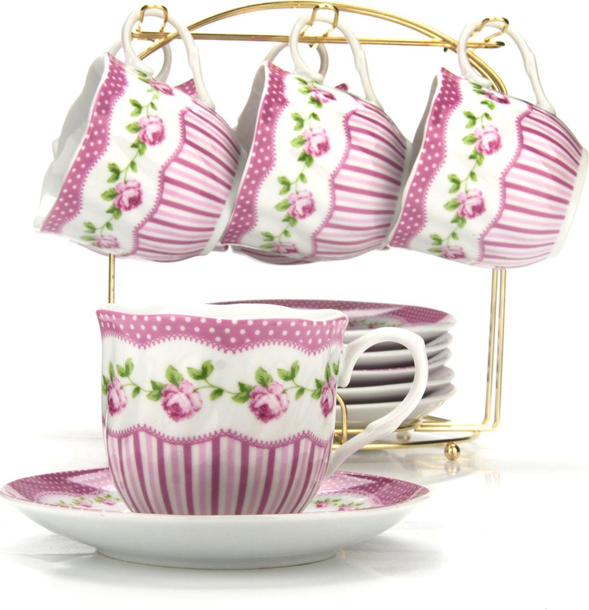 Сервиз чайный Loraine, на подставке, 13 предметов. 4328621395599Чайный набор состоит из шести чашек, шести блюдец и металлической подставки золотого цвета. Предметы набора изготовлены из качественного фарфора и оформлены красочным цветным рисунком, стенки чашек имеют изящную волнистую поверхность. Чайный набор идеально подойдет для сервировки стола и станет отличным подарком к любому празднику. Все изделия можно компактно хранить на подставке, входящей в набор. Подходит для мытья в посудомоечной машине.Диаметр чашки: 8 см.Высота чашки: 7 см.Объем чашки: 200 мл.Диаметр блюдца: 13,5 см.