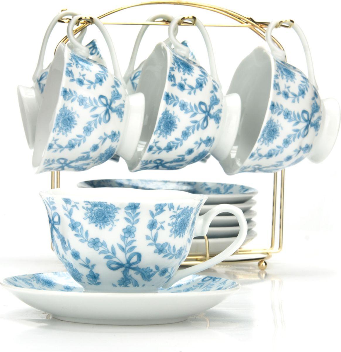 Сервиз чайный Loraine, на подставке, 13 предметов. 43294VT-1520(SR)Чайный набор состоит из шести чашек, шести блюдец и металлической подставки золотого цвета. Предметы набора изготовлены из качественного фарфора и оформлены красочным цветным рисунком. Чайный набор идеально подойдет для сервировки стола и станет отличным подарком к любому празднику. Все изделия можно компактно хранить на подставке, входящей в набор. Подходит для мытья в посудомоечной машине.Диаметр чашки: 9,5 см.Высота чашки: 6,5 см.Объем чашки: 180 мл.Диаметр блюдца: 14 см.