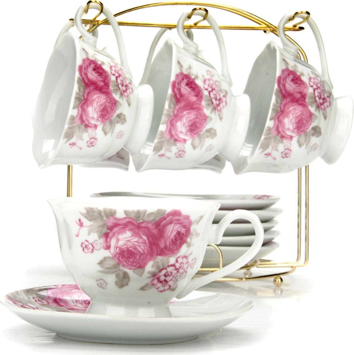 Сервиз чайный Loraine, на подставке, 13 предметов. 4329521395599Чайный набор состоит из шести чашек, шести блюдец и металлической подставки золотого цвета. Предметы набора изготовлены из качественного фарфора и оформлены красочным цветным рисунком. Чайный набор идеально подойдет для сервировки стола и станет отличным подарком к любому празднику. Все изделия можно компактно хранить на подставке, входящей в набор. Подходит для мытья в посудомоечной машине.Диаметр чашки: 9,5 см.Высота чашки: 6,5 см.Объем чашки: 180 мл.Диаметр блюдца: 14 см.