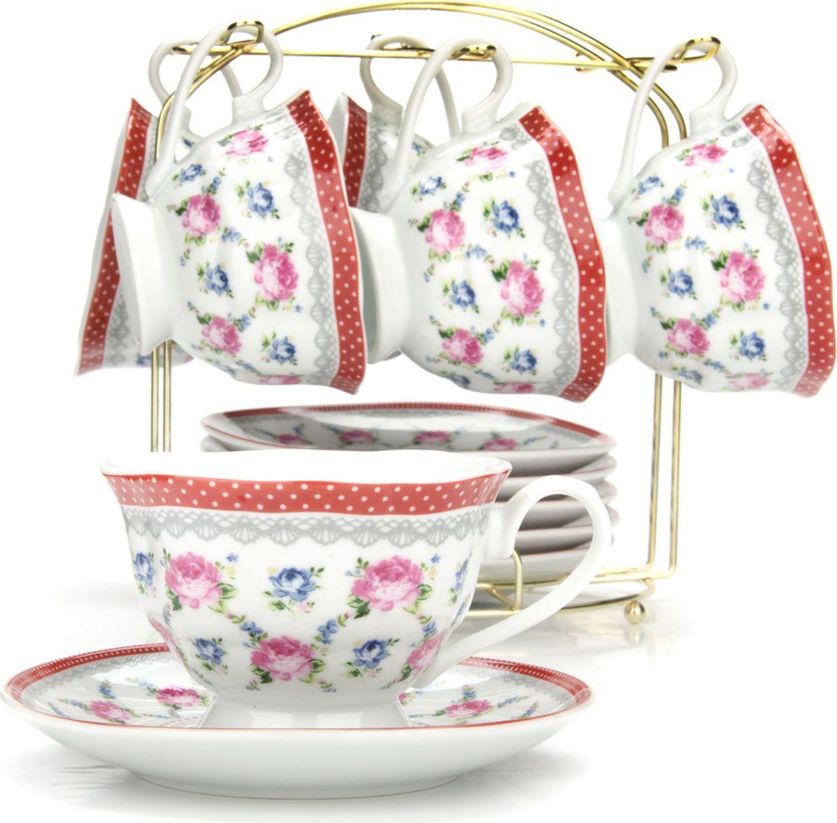 Сервиз чайный Loraine, на подставке, 13 предметов. 4329625947Чайный набор состоит из шести чашек, шести блюдец и металлической подставки. Предметы набора изготовлены из качественного фарфора и оформлены красочным рисунком. Чайный набор идеально подойдет для сервировки стола и станет отличным подарком к любому празднику. Все изделия можно компактно хранить на подставке, входящей в набор. Подходит для мытья в посудомоечной машине.Диаметр чашки: 9,5 см.Высота чашки: 6,5 см.Объем чашки: 180 мл.Диаметр блюдца: 14 см.