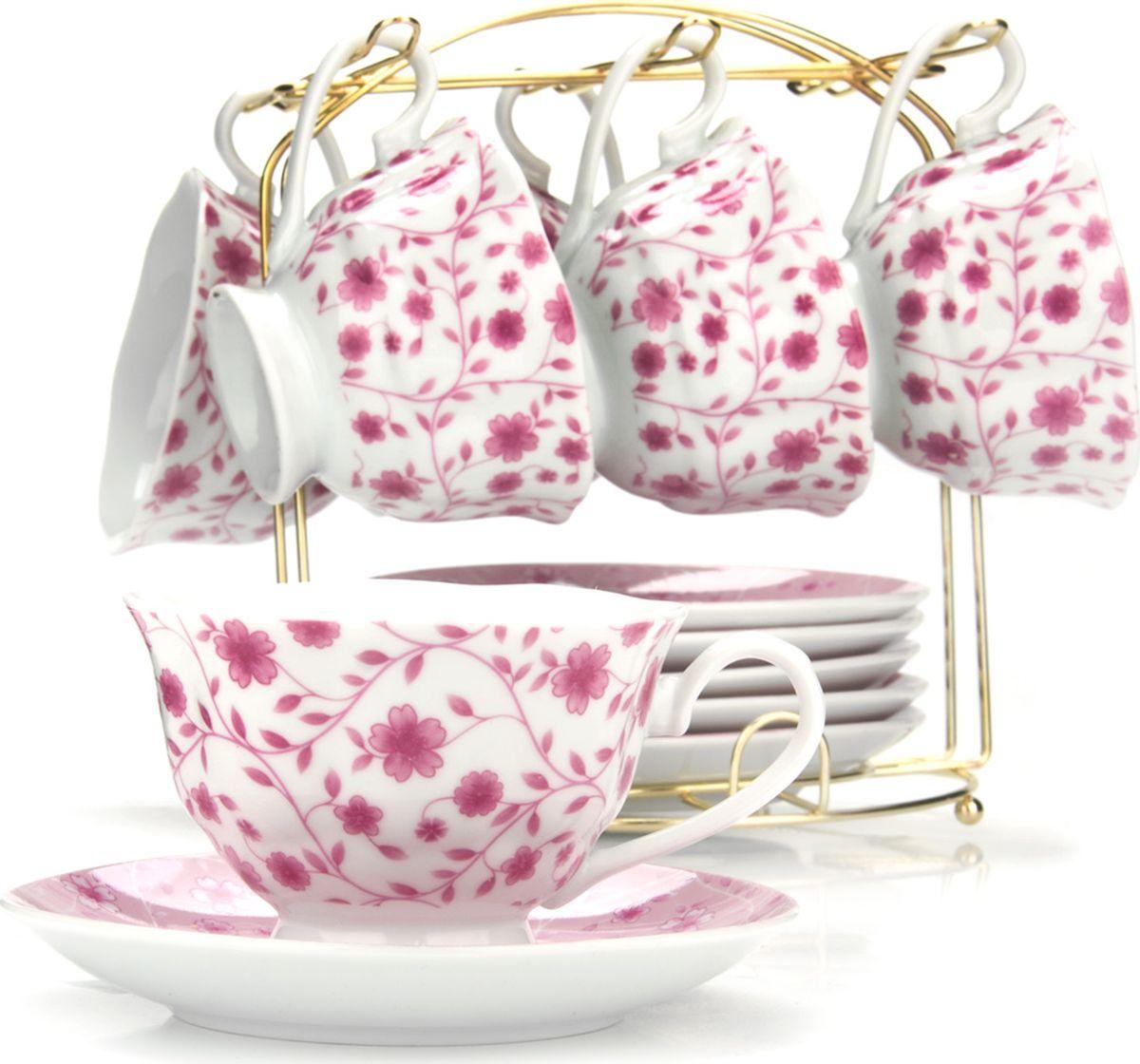 Сервиз чайный Loraine, на подставке, 13 предметов. 43297115510Чайный набор состоит из шести чашек, шести блюдец и металлической подставки золотого цвета. Предметы набора изготовлены из качественного фарфора и оформлены красочным цветным рисунком. Чайный набор идеально подойдет для сервировки стола и станет отличным подарком к любому празднику. Все изделия можно компактно хранить на подставке, входящей в набор. Подходит для мытья в посудомоечной машине.Диаметр чашки: 9,5 см.Высота чашки: 6,5 см.Объем чашки: 180 мл.Диаметр блюдца: 14 см.