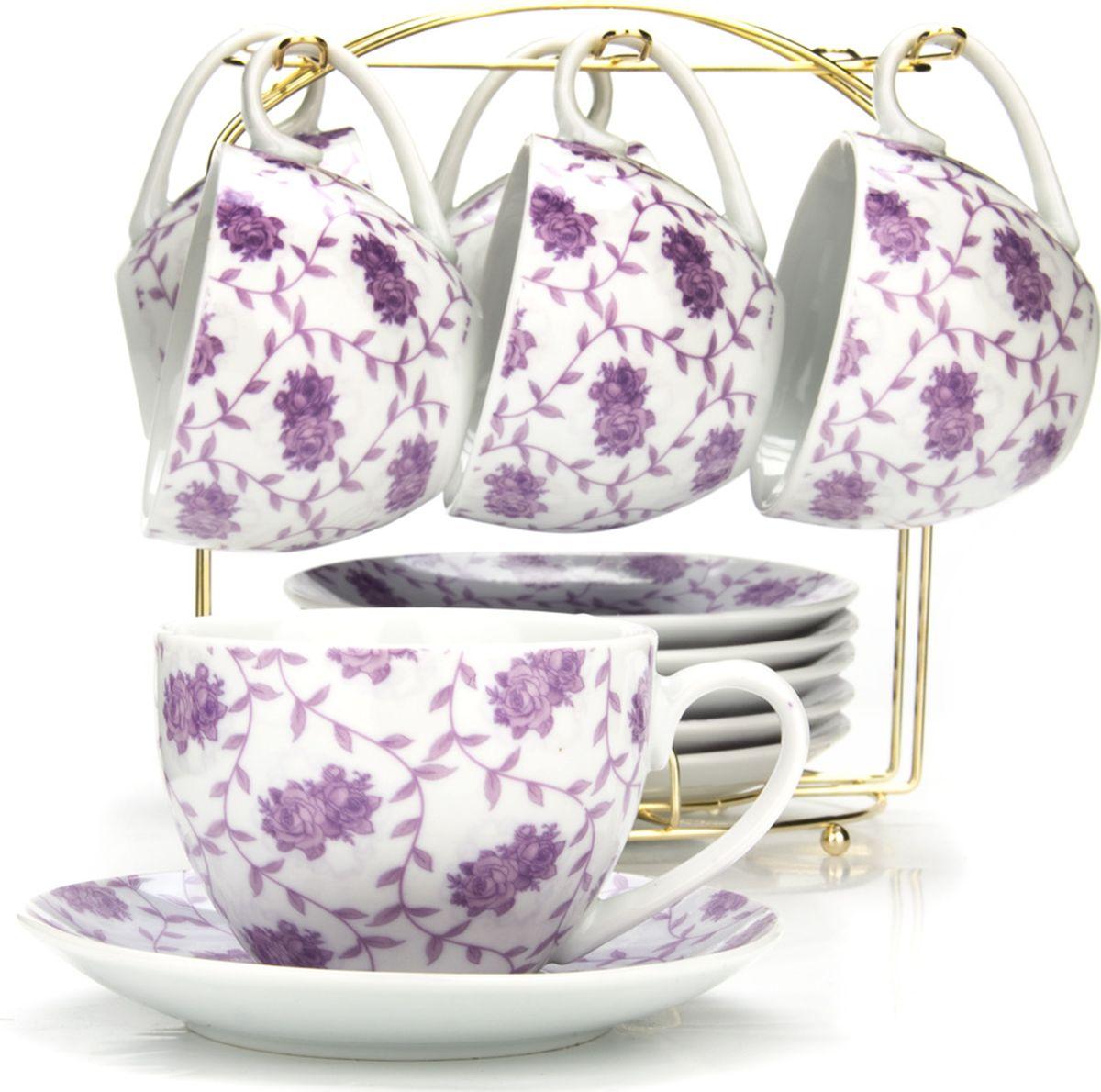 Сервиз чайный Loraine, на подставке, 13 предметов. 43290115510Чайный набор состоит из шести чашек, шести блюдец и металлической подставки золотого цвета. Предметы набора изготовлены из качественного фарфора и оформлены красочным цветным рисунком. Чайный набор идеально подойдет для сервировки стола и станет отличным подарком к любому празднику. Все изделия можно компактно хранить на подставке, входящей в набор. Подходит для мытья в посудомоечной машине.Диаметр чашки: 9 см.Высота чашки: 7 см.Объем чашки: 220 мл.Диаметр блюдца: 14 см.