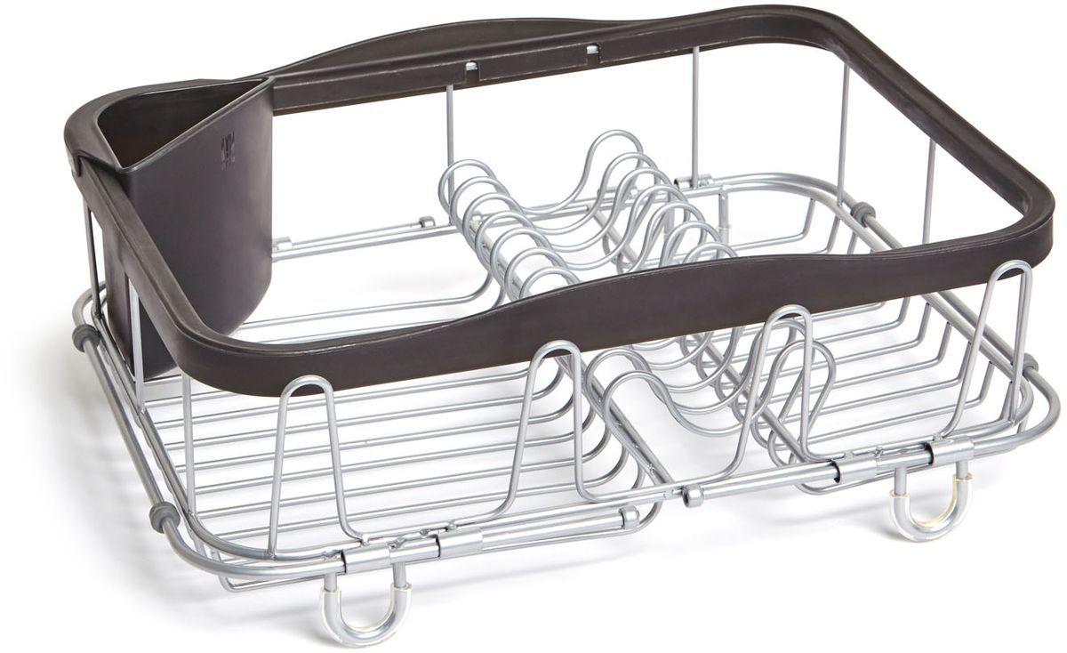 Сушилка для посуды Umbra Sinkin, цвет: черныйFA-5125 WhiteОбновленная модель уже известной сушилки. Добавлены раздвигающиеся ручки для удобного хранения над раковиной. Теперь сушилку можно хранить непосредственно в раковине, над раковиной (если там размораживаются продукты, например) и на кухонной стойке. С боковой стороны добавлены 4 удобных выступа для сушки стаканов или чашек. По-прежнему, в комплект входит съёмный уголок для хранения столовых приборов. Ручки раздвигаются до 48.5 см.Дизайнер Umbra Studio
