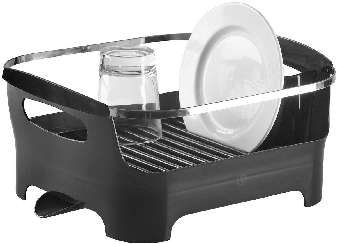 Сушилка для посуды Umbra Basin, цвет: серыйFD-59Современный дизайн создается ради удобства и функциональности, поэтому гениальная сушилка Umbra Basin отличается от всех своих предшественников времен наших бабушек и дедушек. Пространство для посуды отделено от внешнего мира бортиком: в нем есть удобные ручки для переноски, а главное, тарелки случайно не выпадут и не разобьются. Вода со свежевымотой посуды через желобки для тарелок стекает вниз, в специальное отделение, где собирается и выводится через носик на боку сушилки. Вы можете поставить ее в раковину или на рабочую поверхность рядом. Изготовлена из высококачественного пластика без содержания вредного бисфенола.